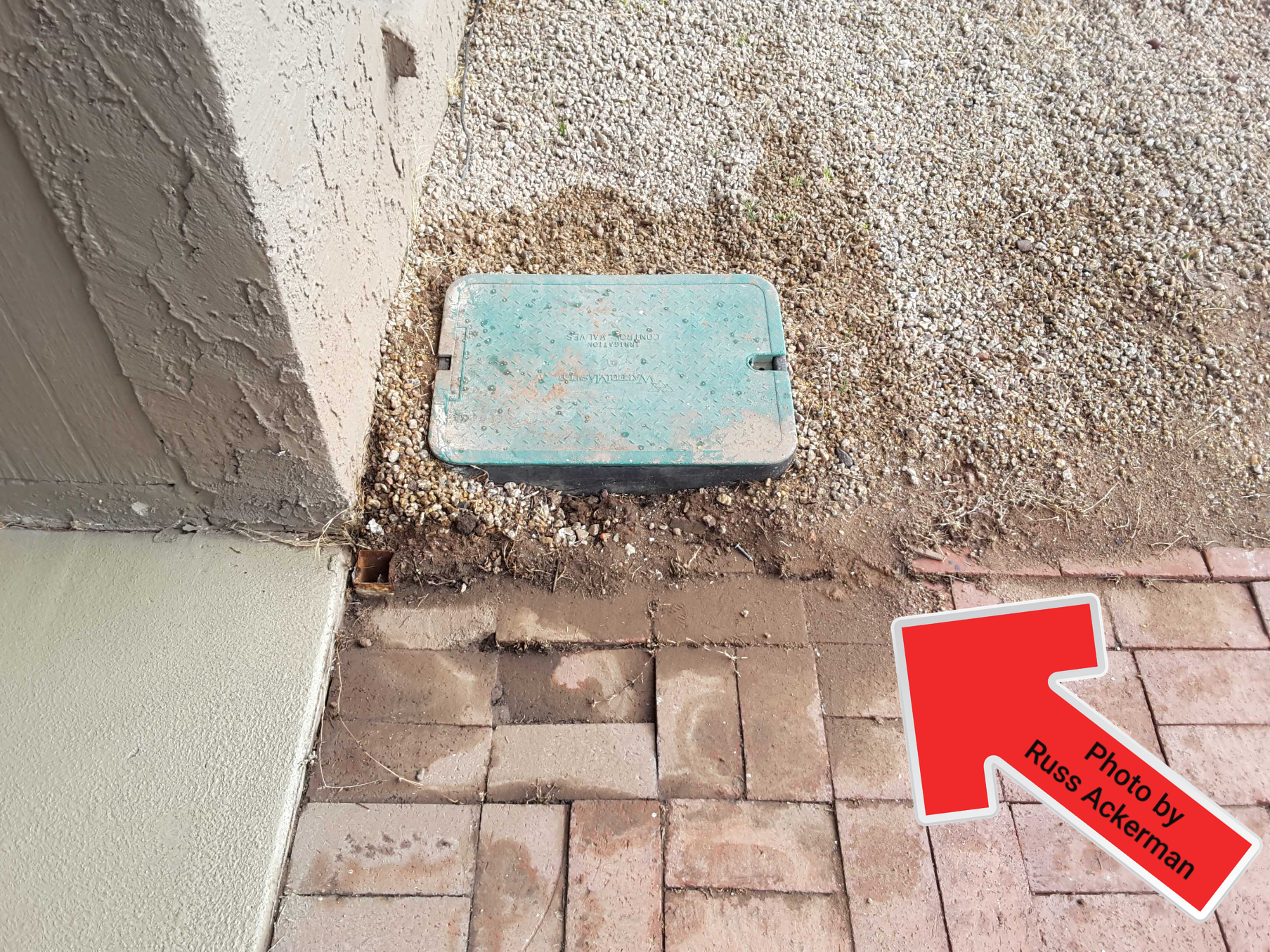 It hasn't rained in a long while and there is evidence of pooling water around a sprinkler valve box. Leaking at the manifold is a certainty.