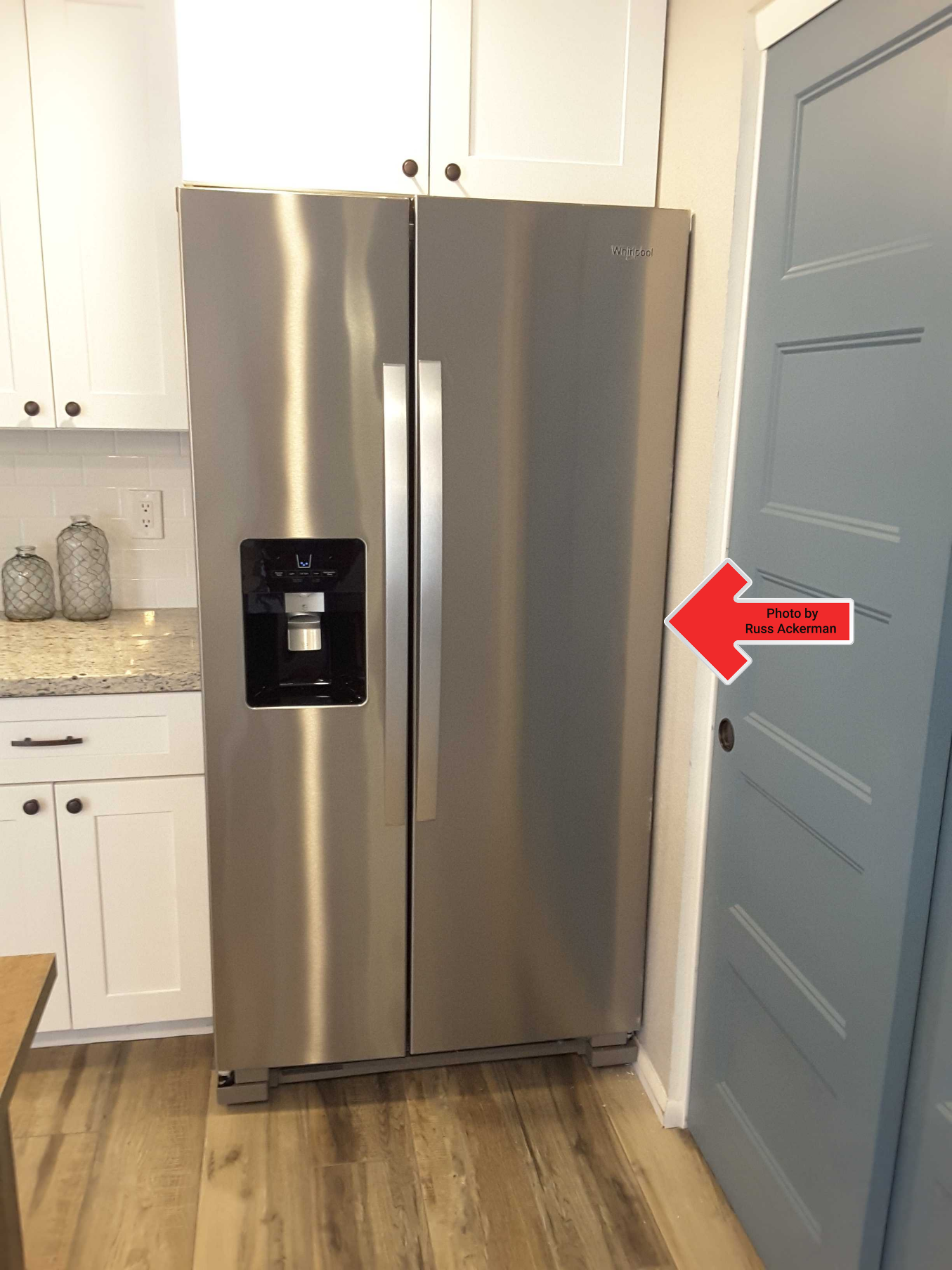 This brand new refrigerator is too wide preventing the door from opening fully. Due to poor planning, it'll need to be replaced for a smaller unit.