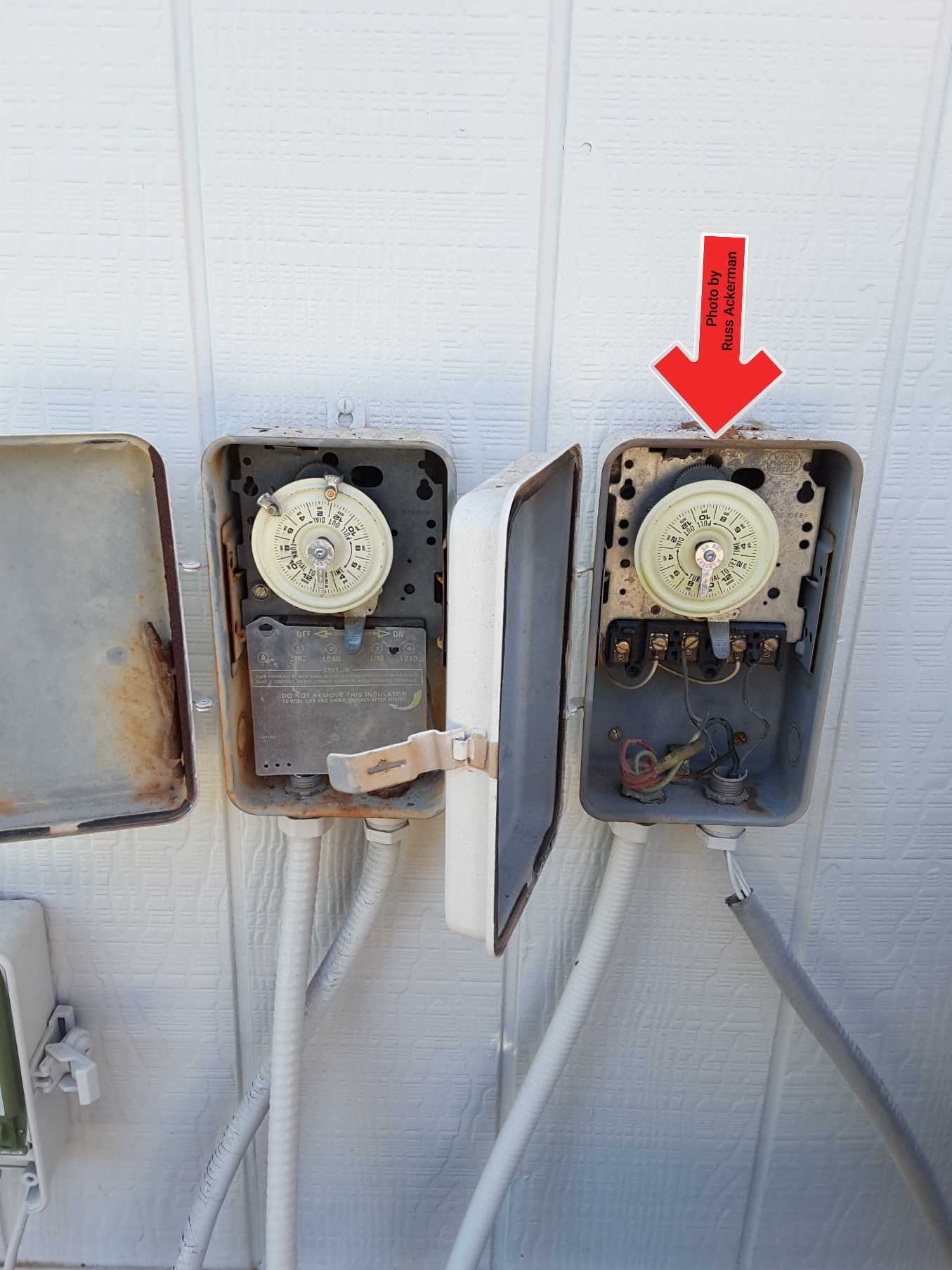 An abandoned pool timer still connected with exposed lives wires. This lazy incomplete job has created a significant safety hazard.