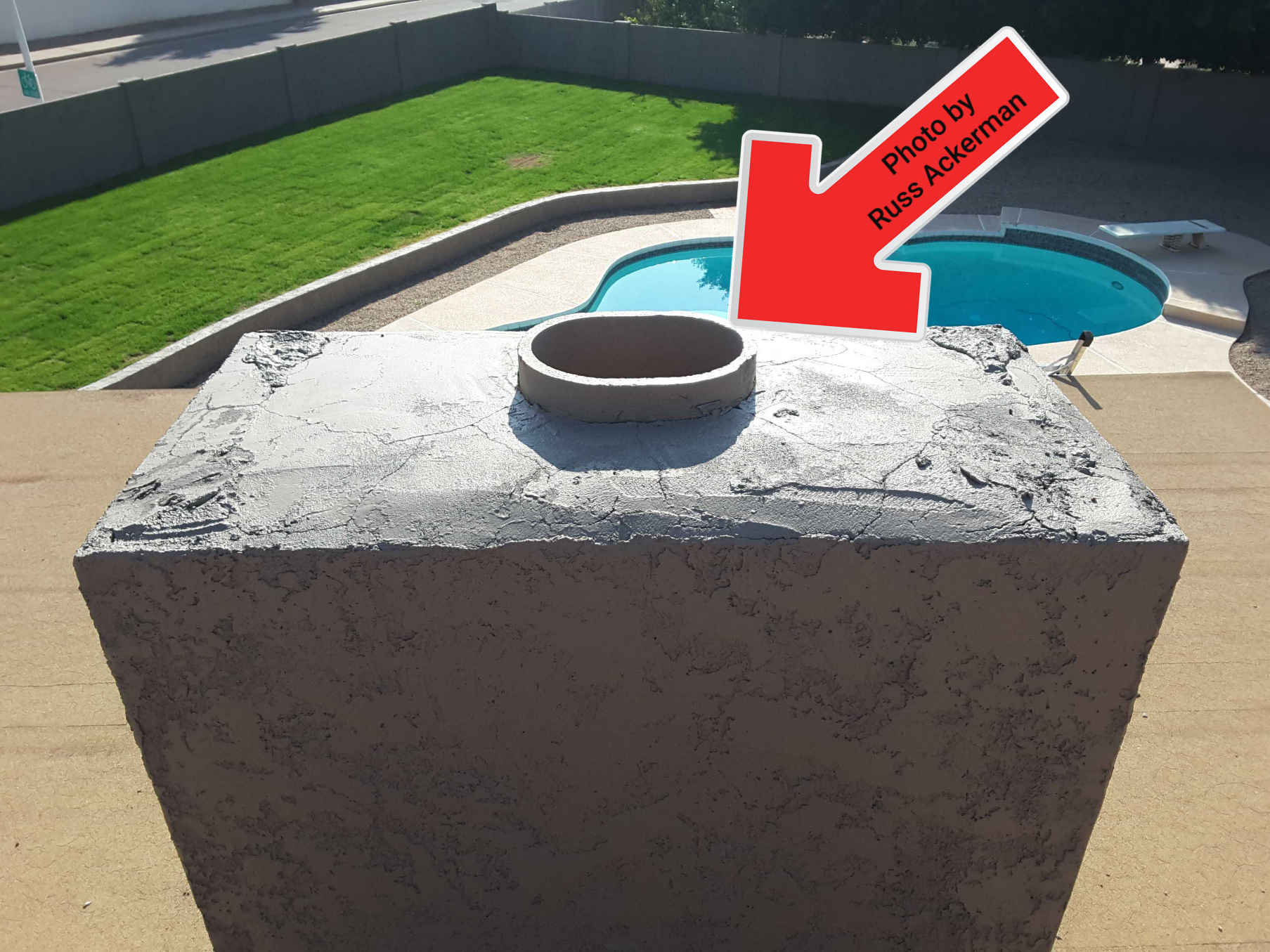 A screened whether cap is needed at this chimney flue. This will keep water out, reduce the spread of fires and keep animals from nesting inside flue.