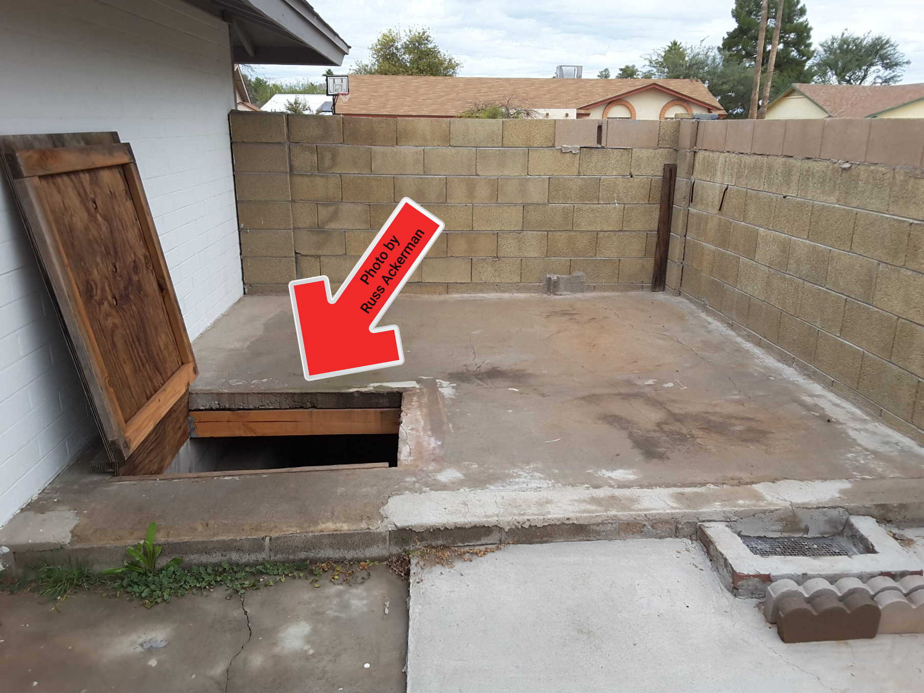 This underground storage area was built with poured concrete over a untreated wood frame. It was settling, cracking and had wood rot and termite damage. A possible collapse/life safety hazard.