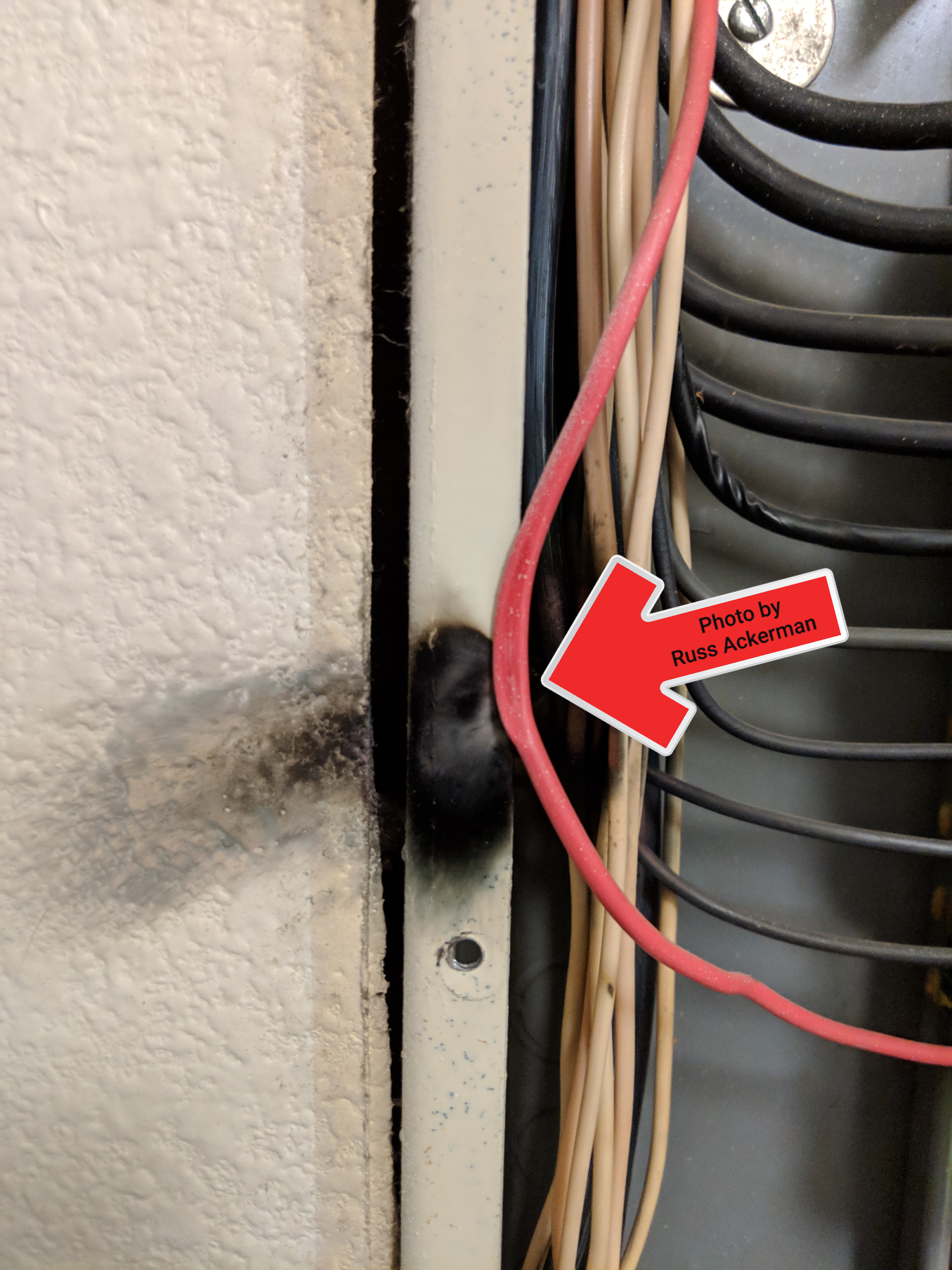This electrical panel deadfront cover was mashing a wire, when I removed the cover it shorted out with a loud pop and arc. Always give your inspector a lot of space when they're inspecting the electrical panel.