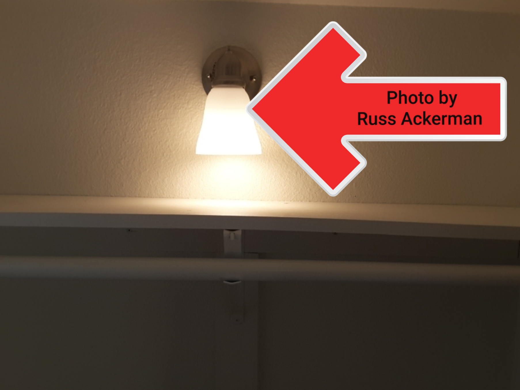 """This closet light fixture was only 3"""" away from the shelving creating a potential fire hazard. Recommend removal or relocation."""