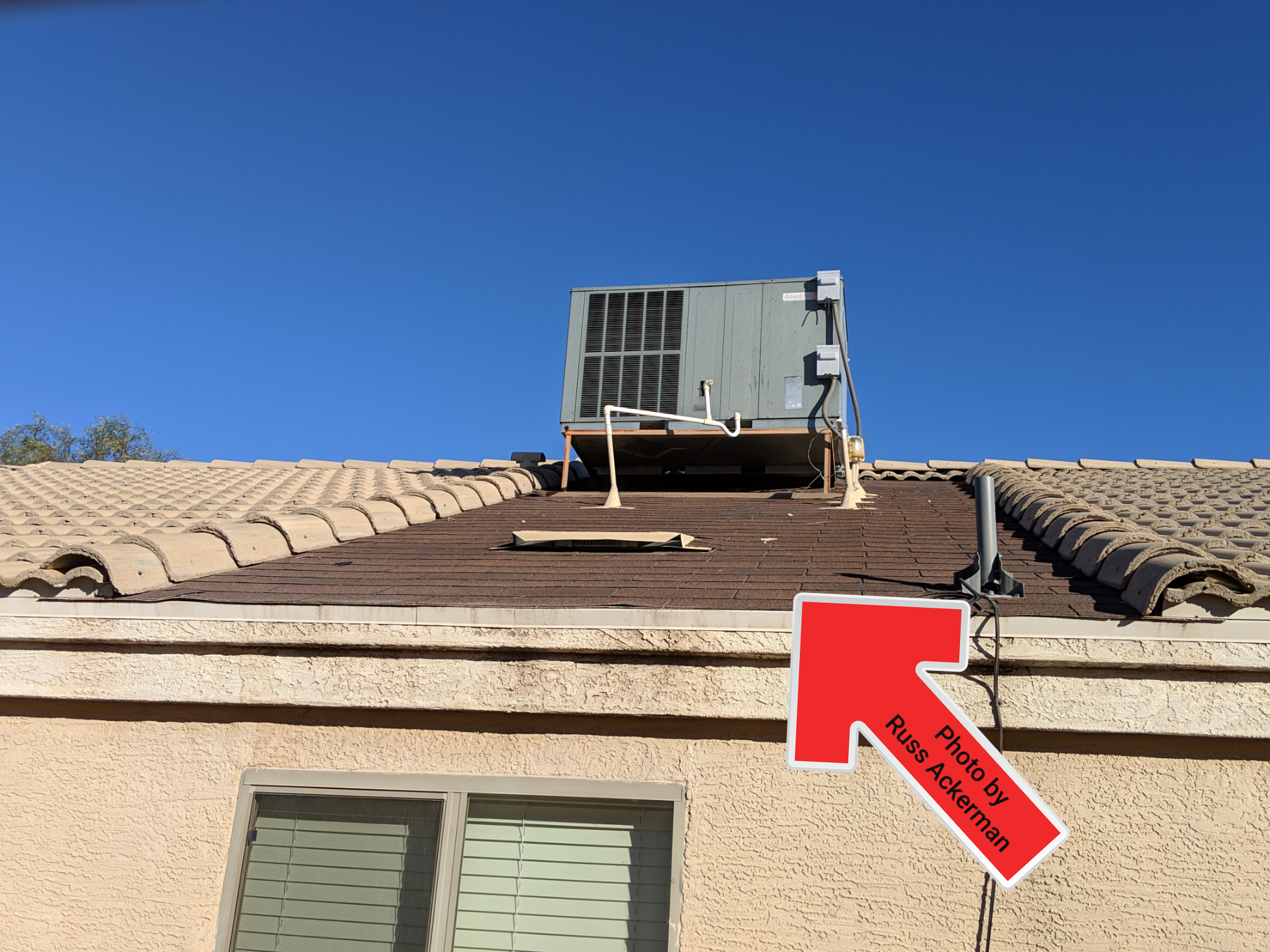 Asphalt shingles near HVAC equipment often have a lot of scuffing and granule loss from technicians walking haphazardly on roof.