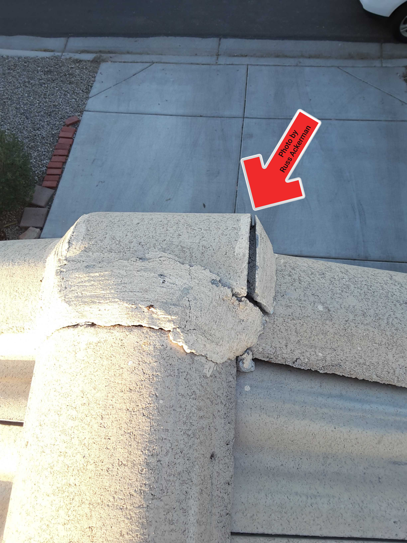 Cracked/deteriorated mud balls at roof ridge are in need of replacing to reduce the chance of water entry.