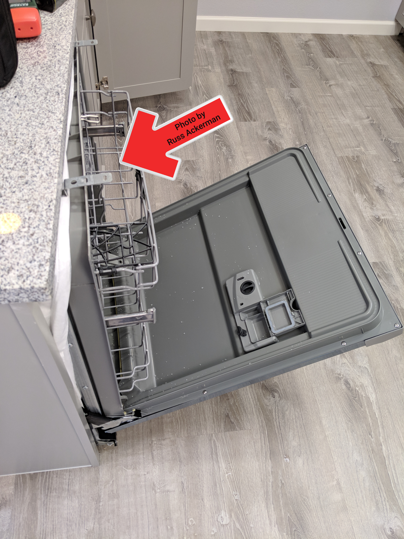 This dishwasher was loose and needs to be secured to the bottom of the countertop or cabinet sides.