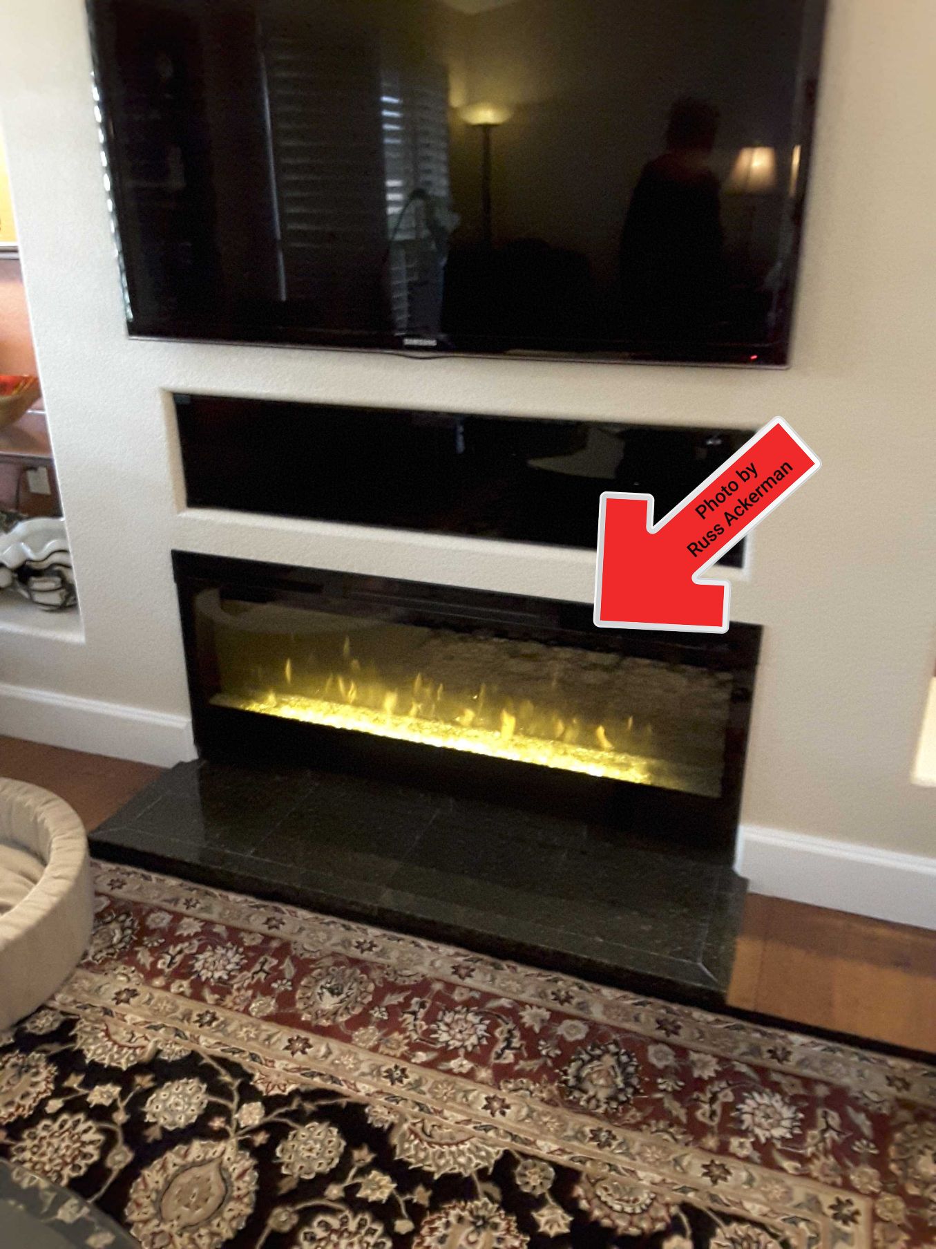 Even though this is just a light show versus a real fireplace, I would still test them if the remote was accessible.