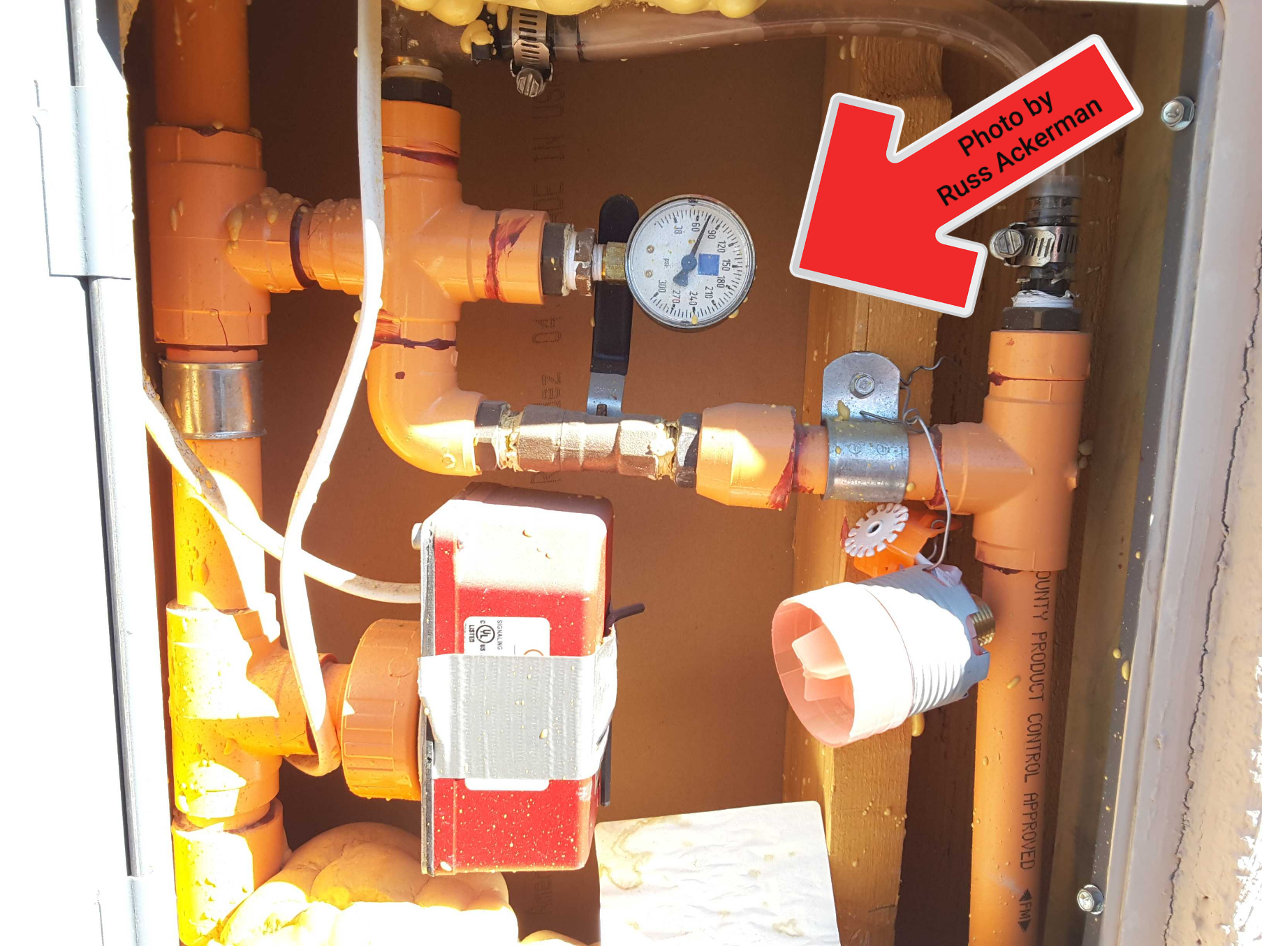 Apart from checking for leaks, fire sprinkler systems are beyond the scope of a typical home inspection. Any orange piping you see is related to this system.