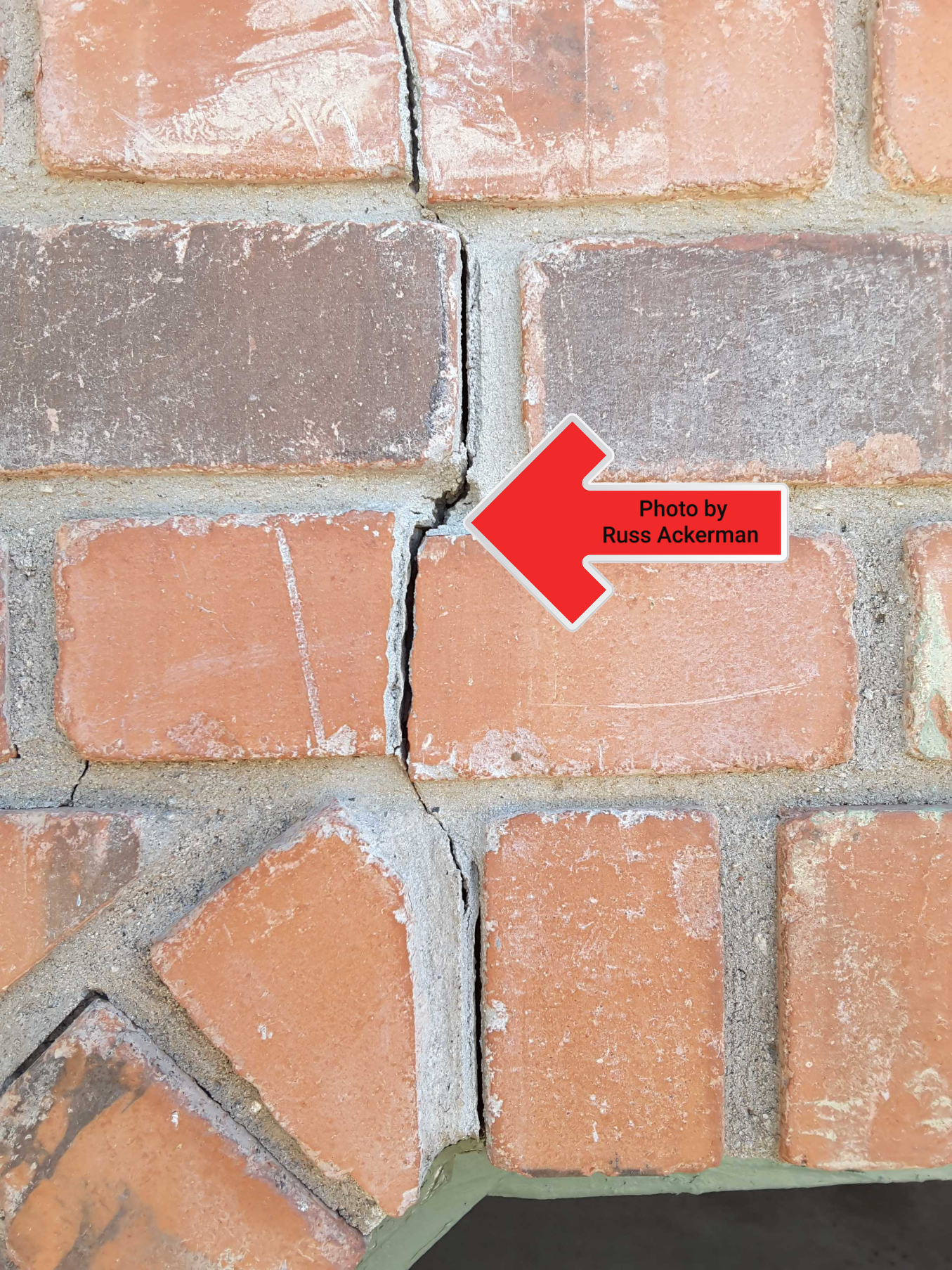 Settling cracks are common above a overhead garage door lintel, tuckpoint gaps and monitor for future movement.