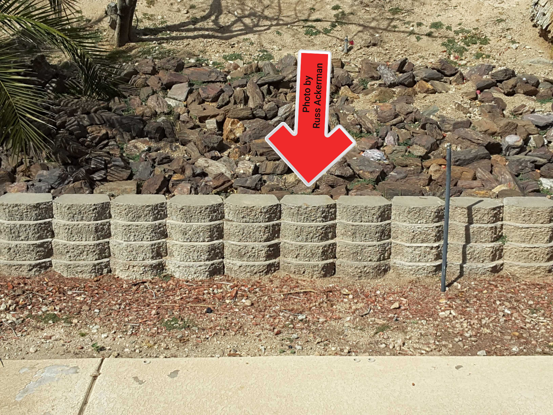 A poorly constructed retaining wall with the blocks aligned vertically rather than staggered will likely fail sooner than expected.