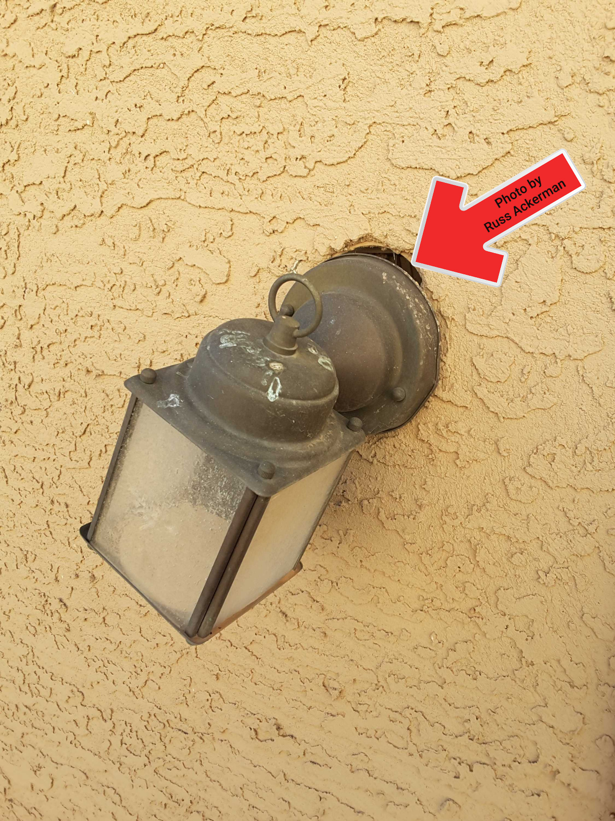 A loose light fixture, missing bulb and potential water entry point could have been an easy fix before listing the home.
