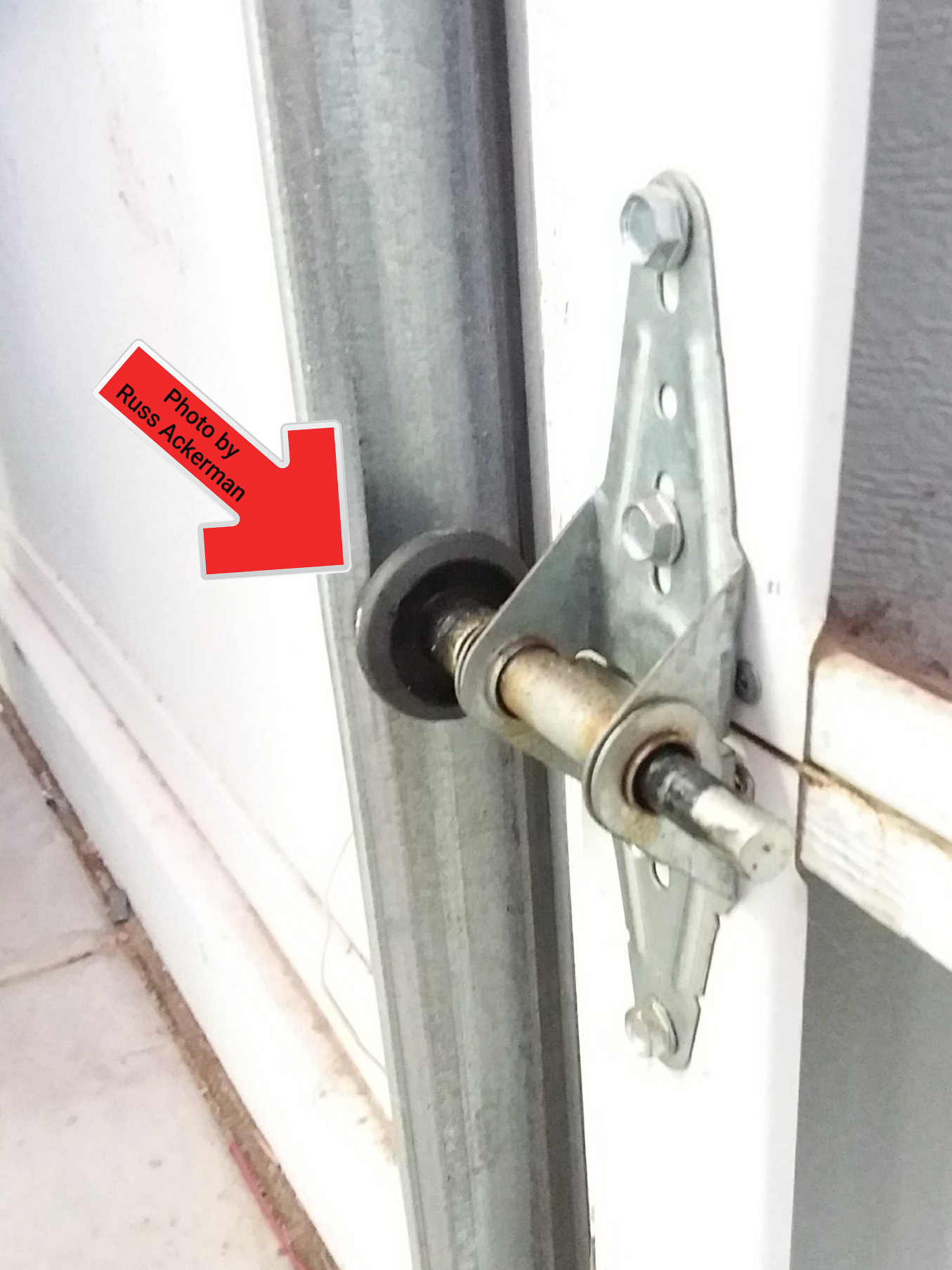 With a pair of channel lock pliers or vice grips, you can gently bend a garage door track which will allow you to pop a stray roller back into place.