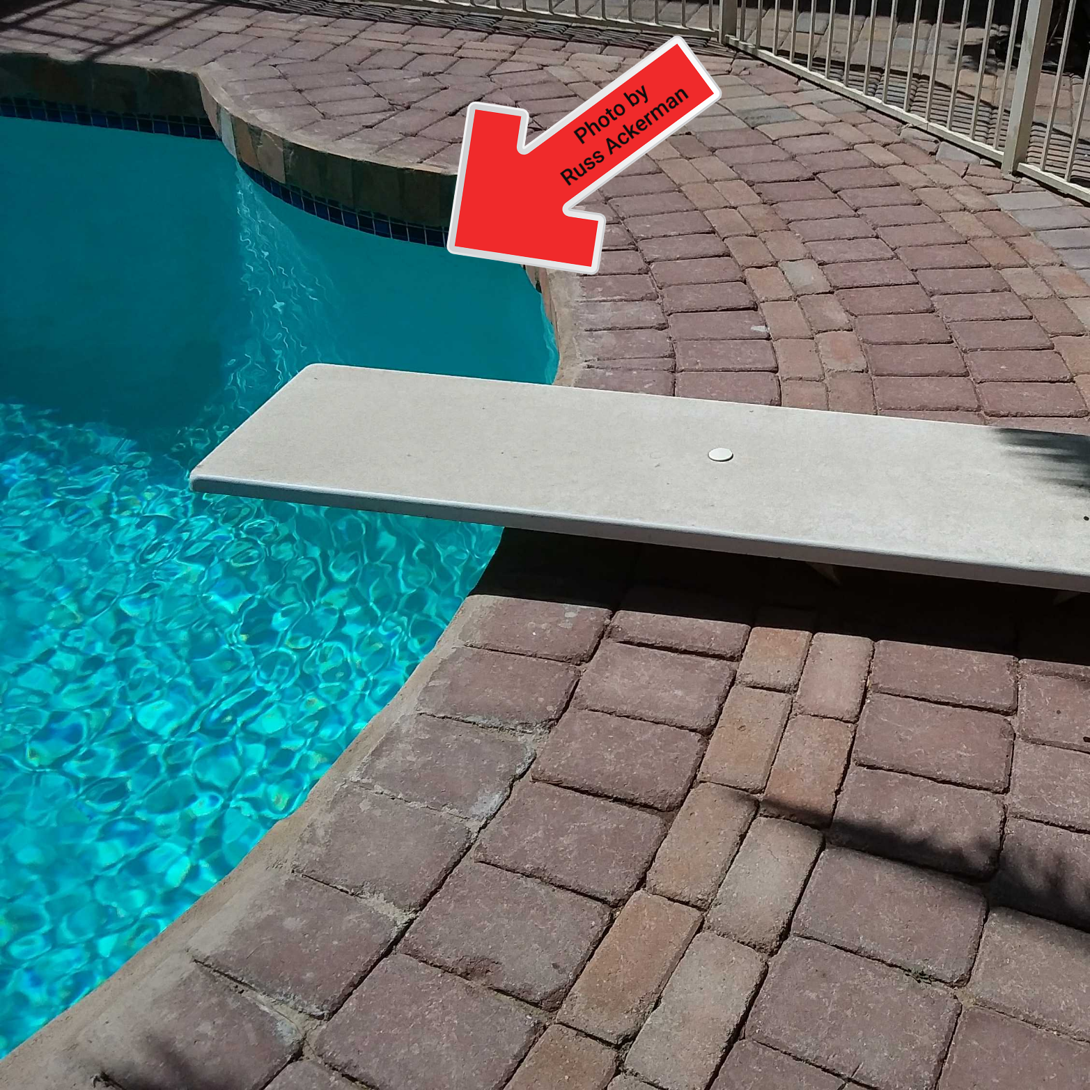 A ladder, handrail and light are highly recommended at the deep end of diving pools, to create proper egress.