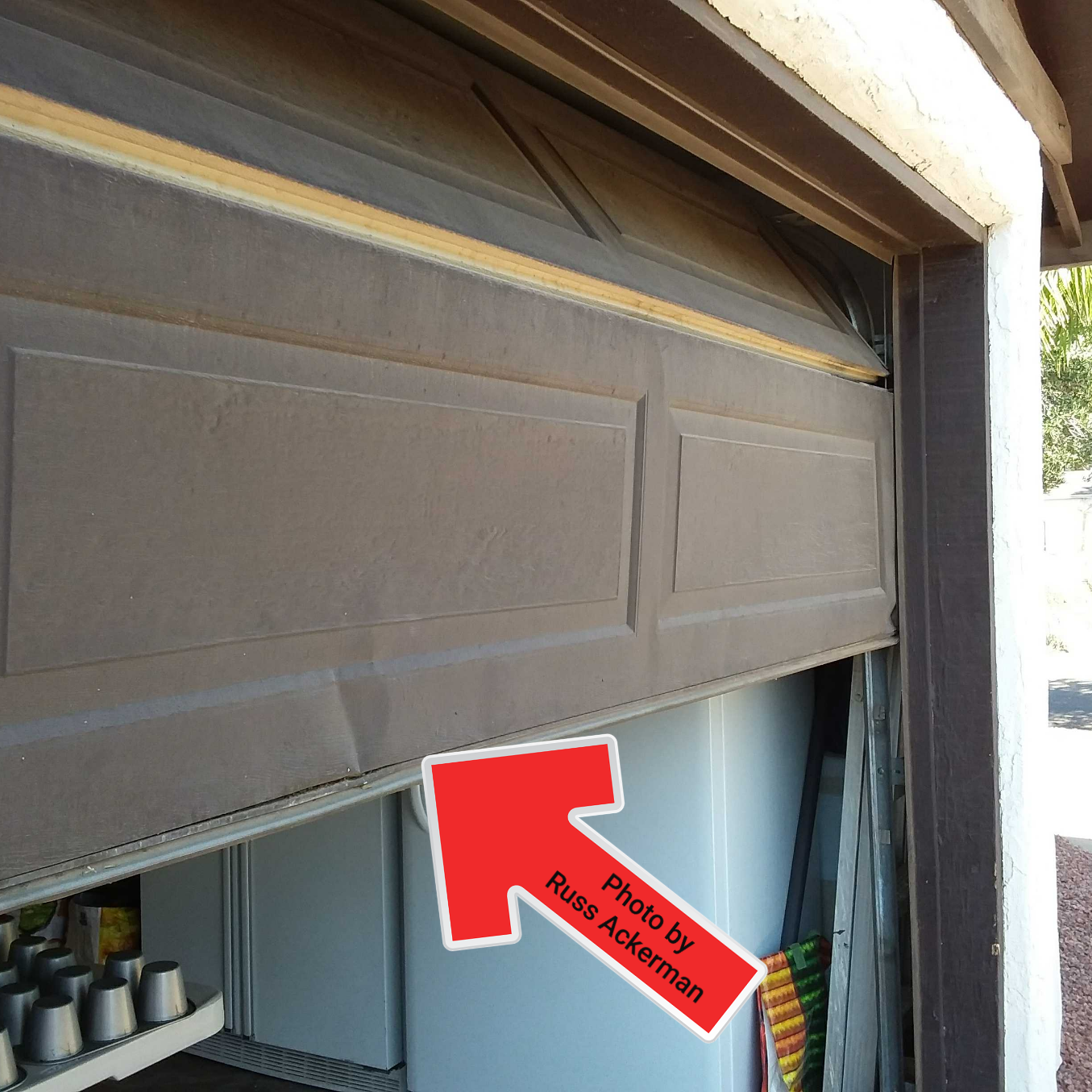 Bottom garage door panels often gets bumped by a car and usually does not hinder the operation of the door.