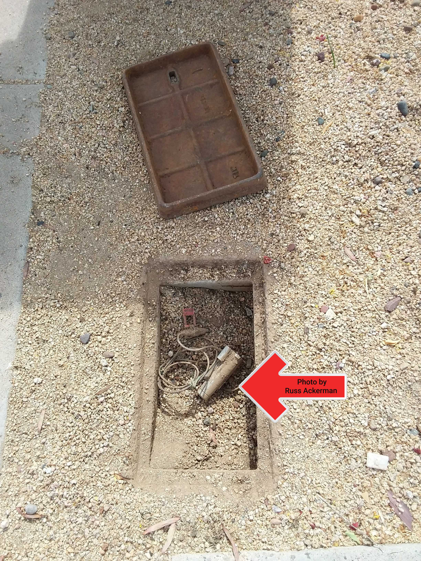 This water meter is MIA. Water meters should not be buried under piles of rock and dirt, but often are.