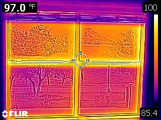Failed window seals at the top two windows are easy to spot with infrared