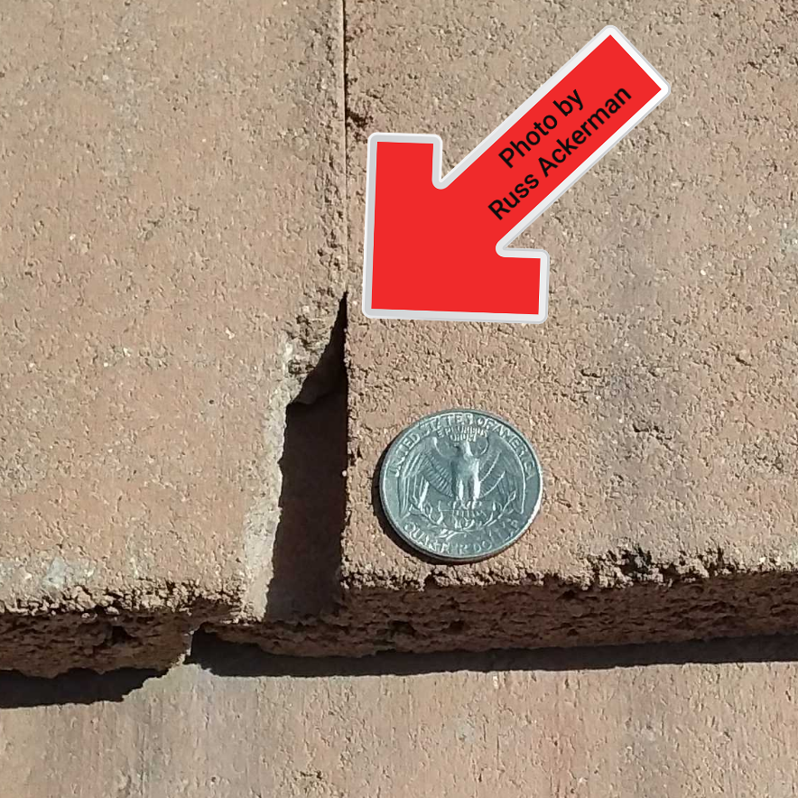 Arizona standards state that any roof tile with a chip or crack larger than a quarter, the tile should be replaced.