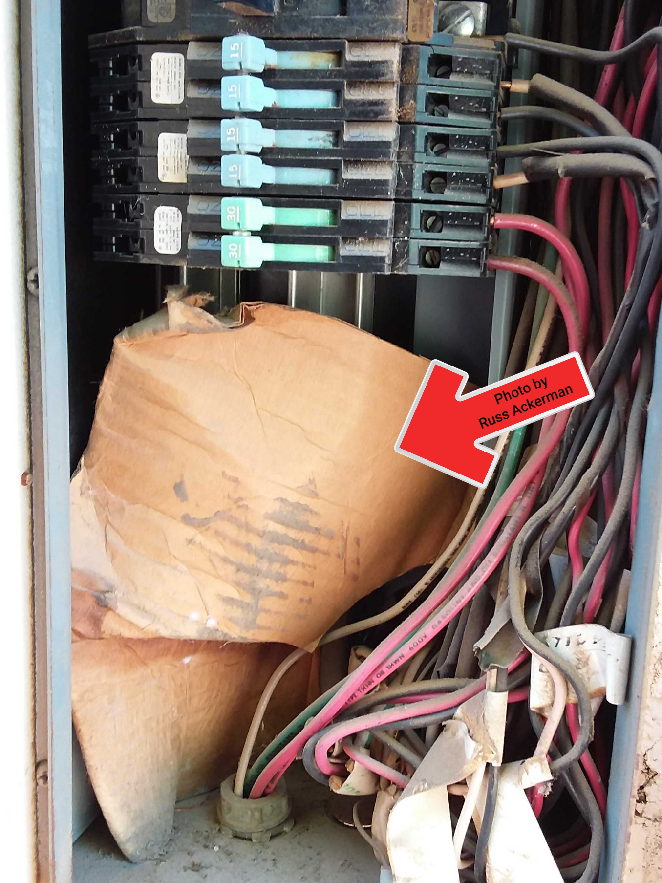 Zinsco electrical panels already have enough problems, storing flammable materials against a live bus bar is not helping anything.