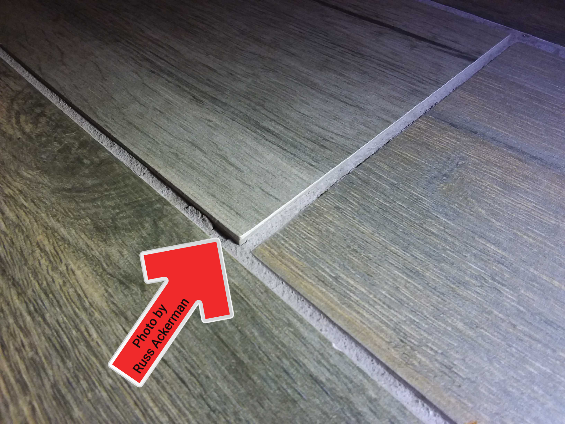 Floor tiles that don't lay flat could become a potential trip hazard and could easily crack or break.