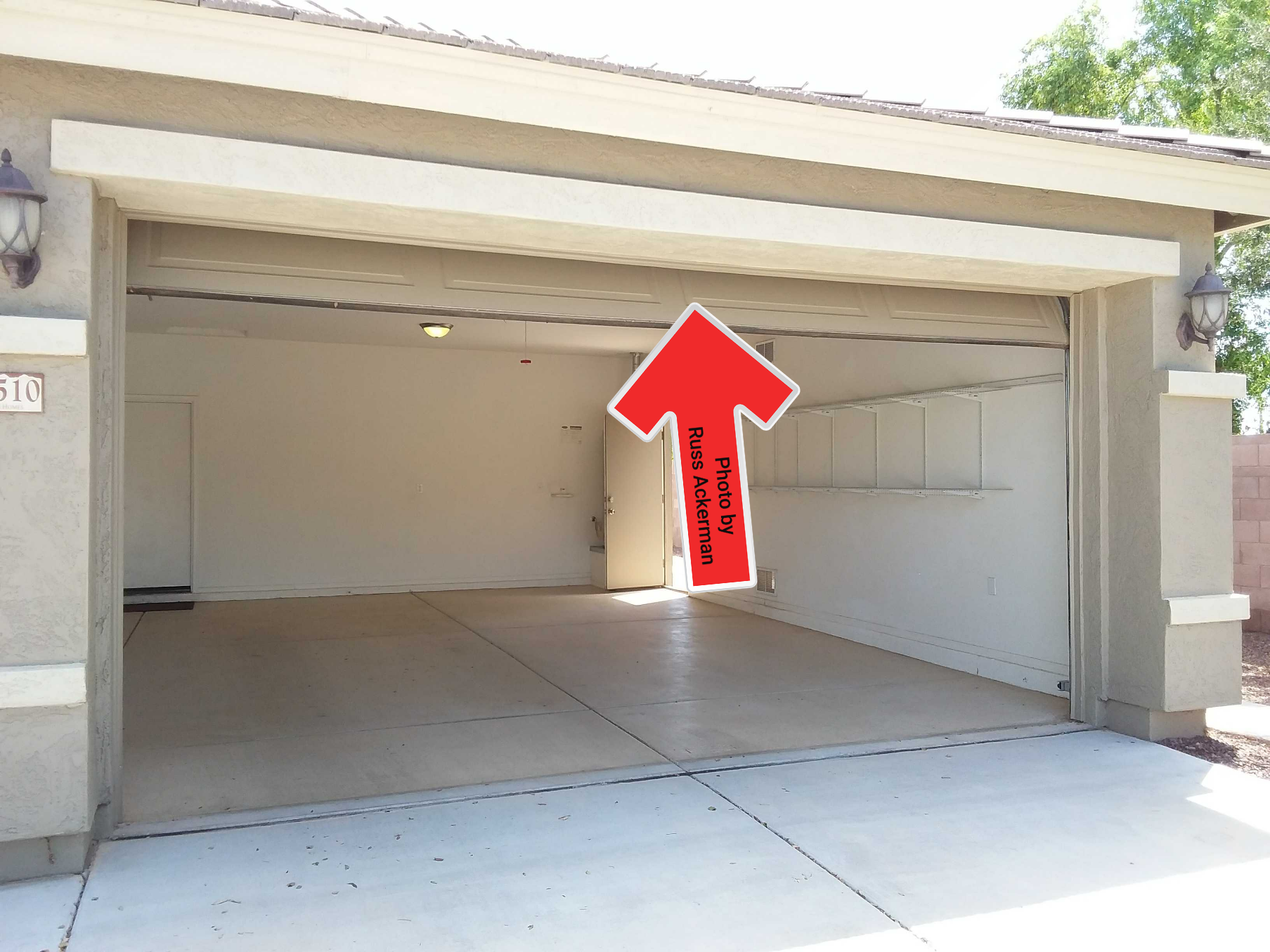 A overhead garage door that does not open fully may damage your vehicle and the door.