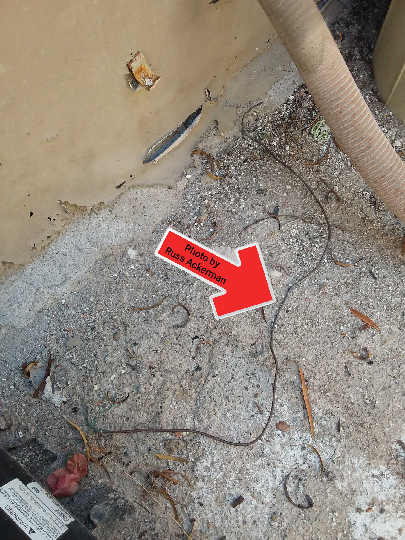 A bonding wire laying on the ground next to your pool equipment is serving be purpose. This is a safety hazard.