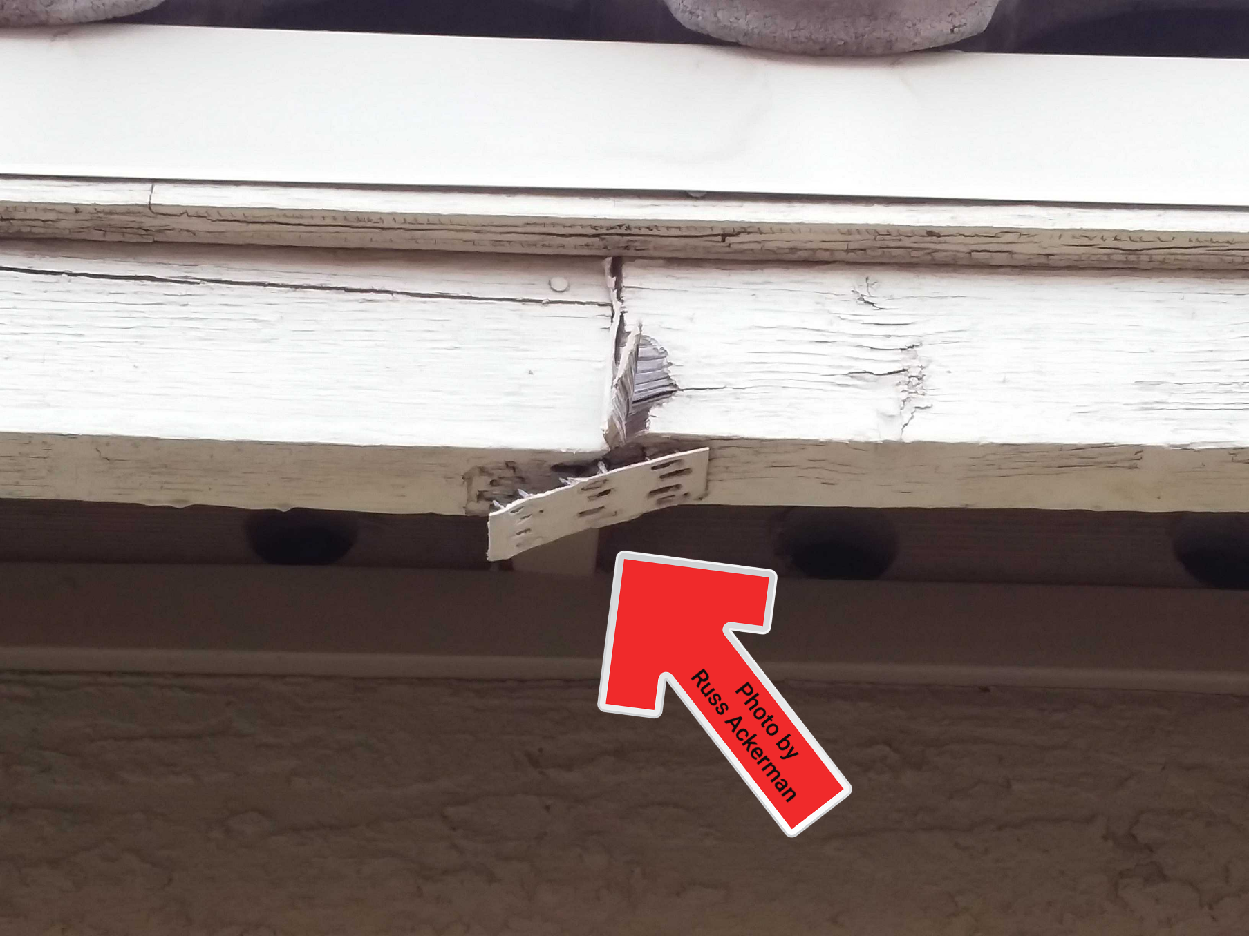 A loose gusset plate at this fascia can easily be hammered back into place, then finish off with a little caulk and paint.