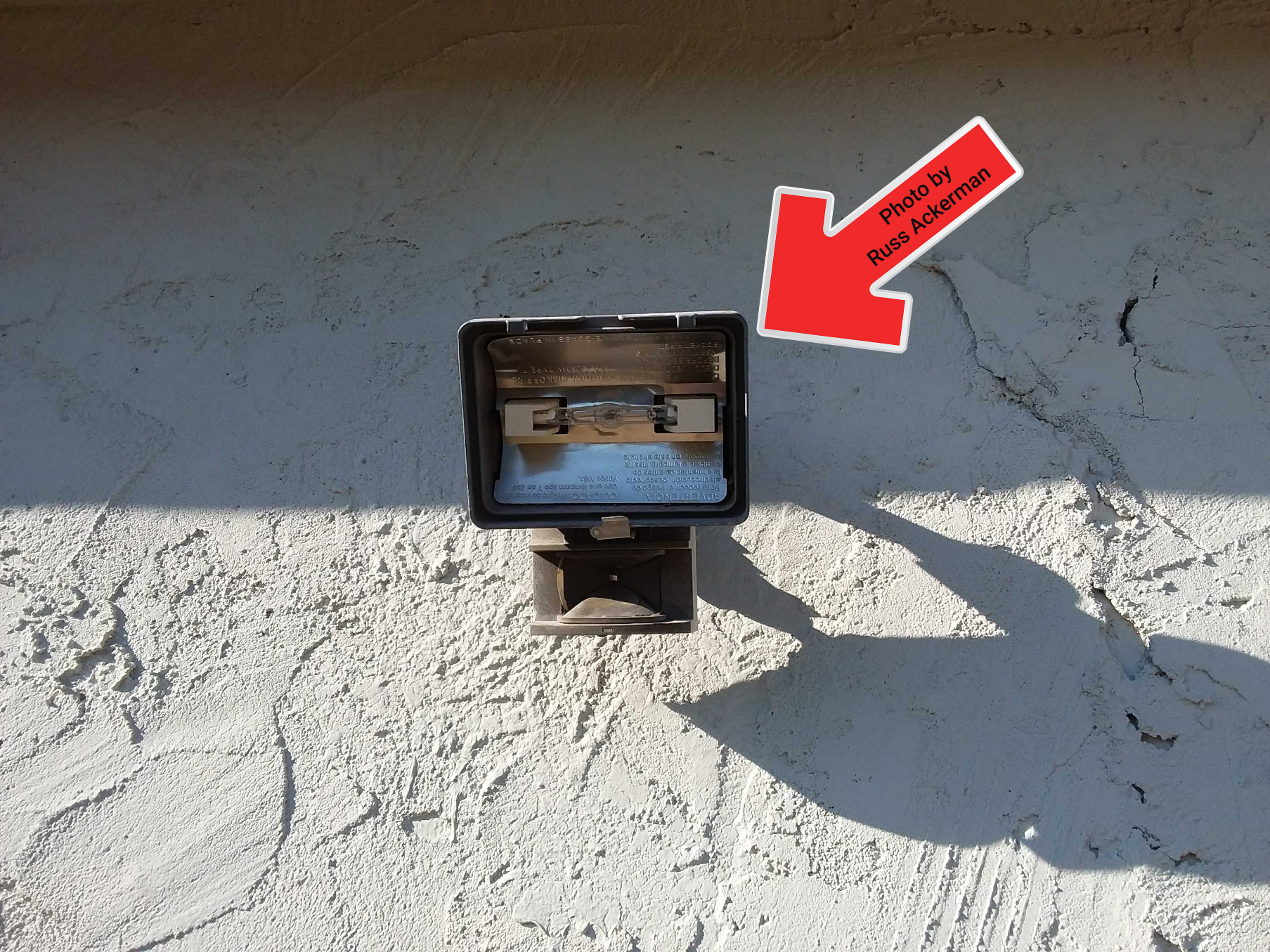 A missing glass cover to a halogen light could be a huge safety hazard as these lights heat up to well over 1000°F.
