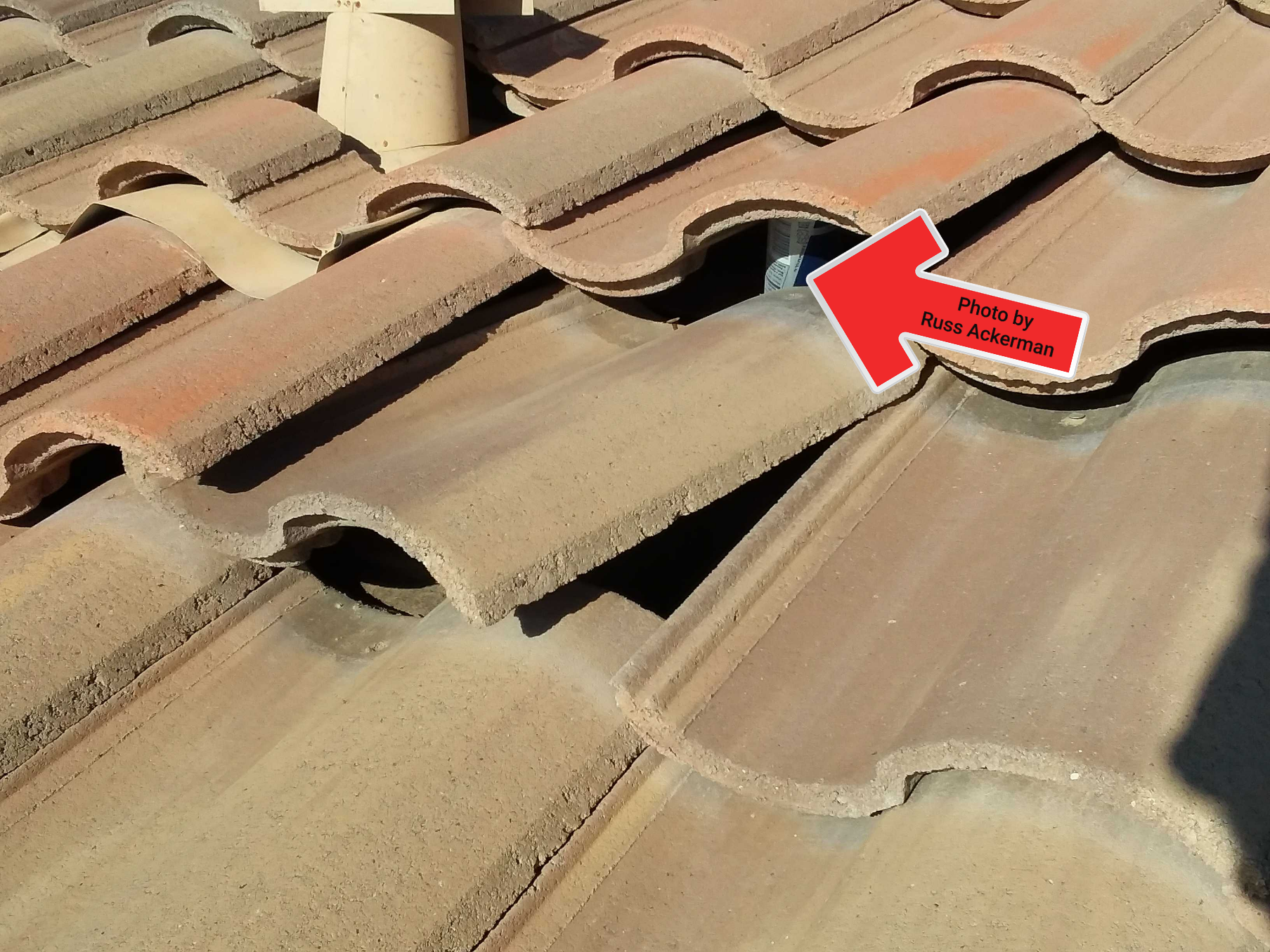 Whoever replaced the mud balls on this roof left their Red Bull can jammed under a couple roof tiles. Not a roofer I would allow on my roof.