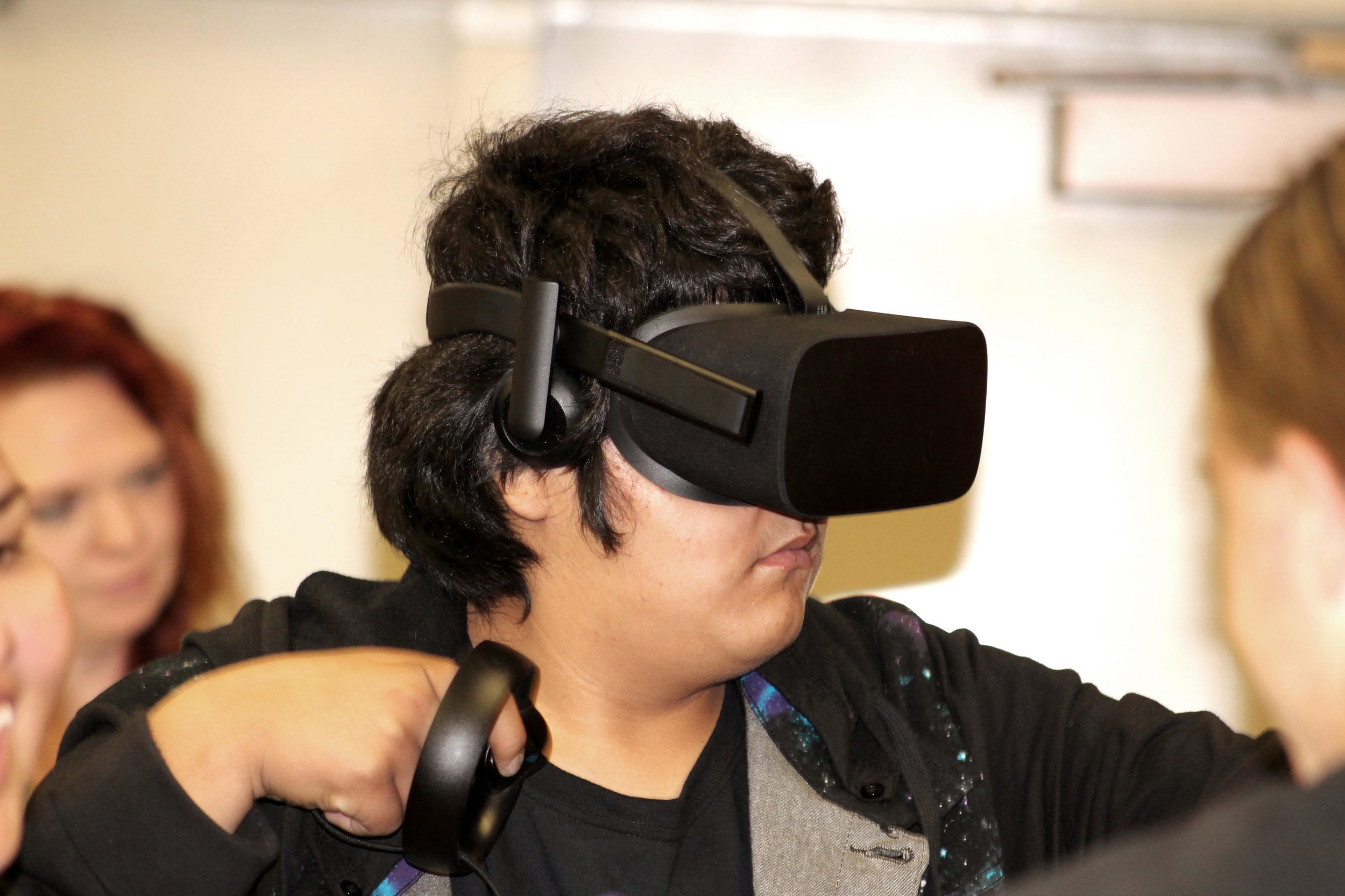 Whitehorse Student Kyle tries out VR Technology.