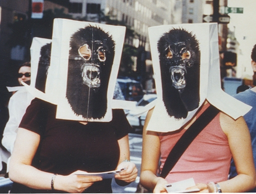 Two women don gorilla paper bag masks, handed out by the Guerrilla Girls during the 2000 TONY Awards protest. (Photo provided by Donna Kaz).