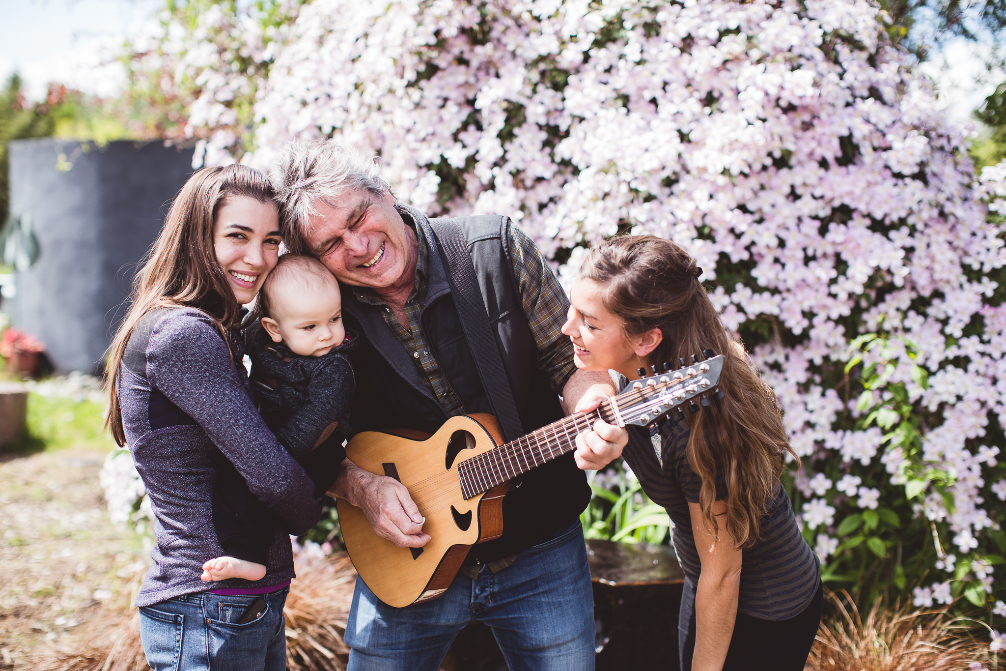 Roger with daughters and grandson