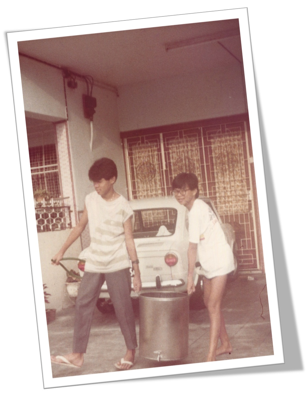 2 skinny guys preparing bandung drink using rose syrup, evaporated milk and ice