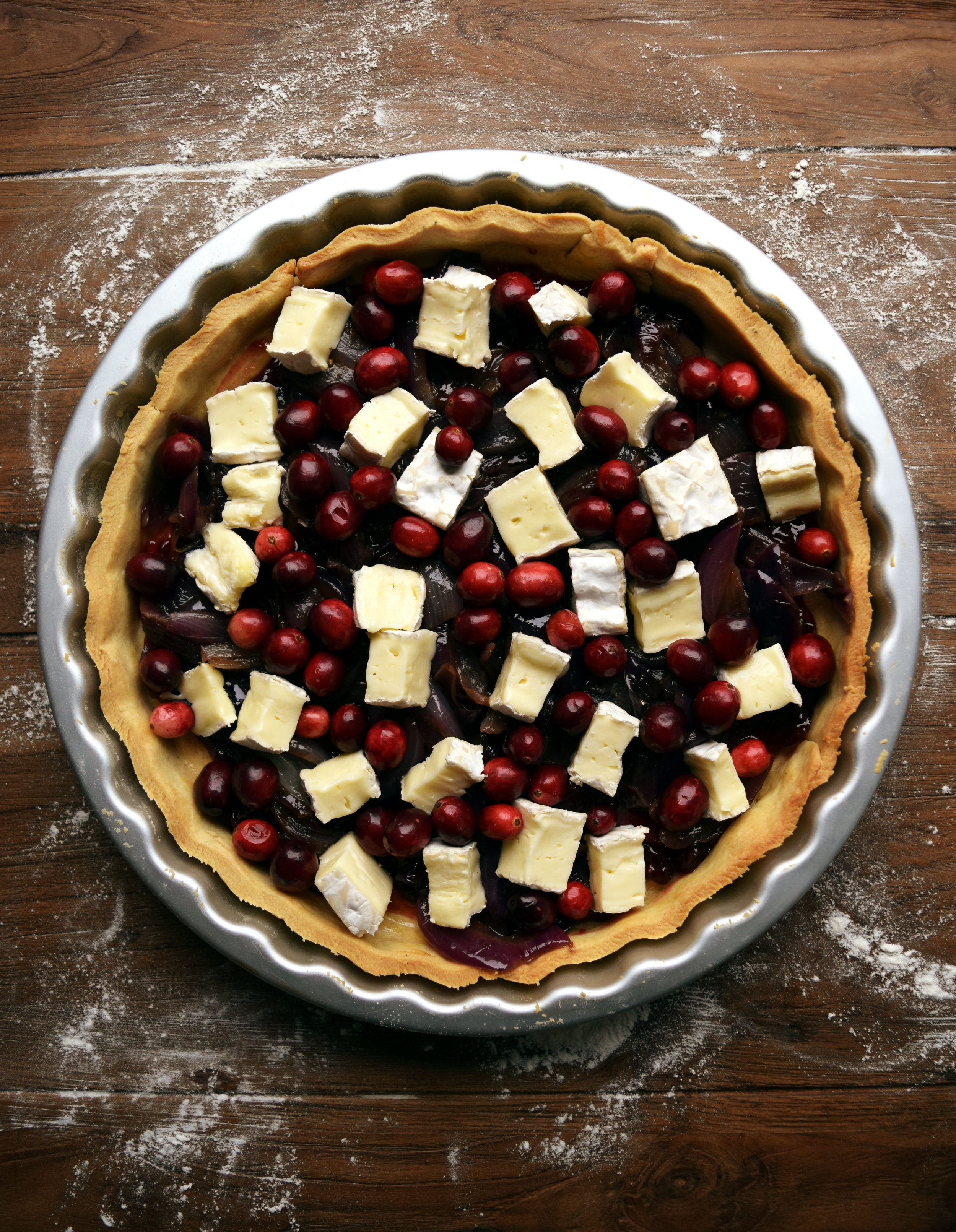 A festive tart filled with brie, cranberries and caramelised onions.