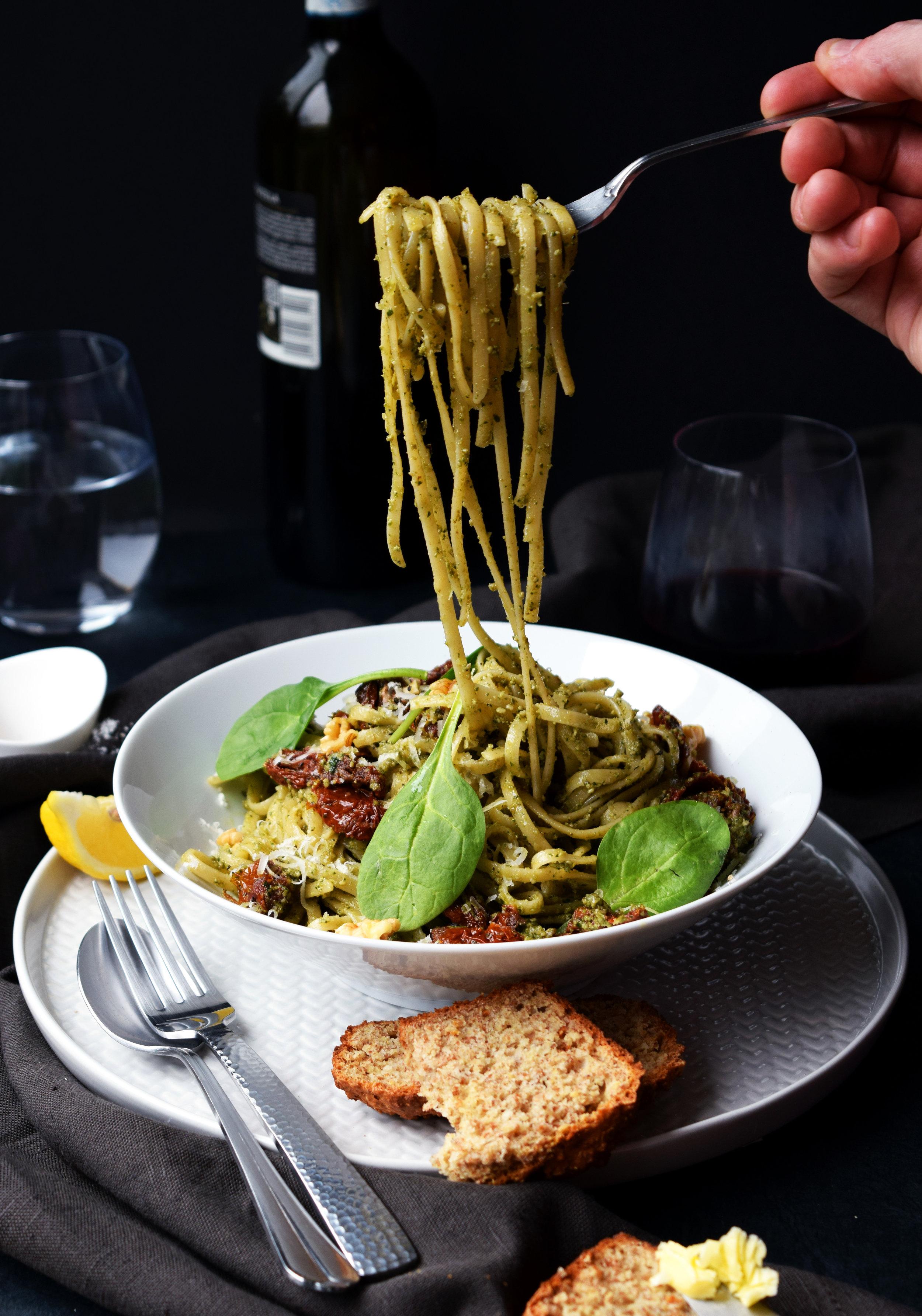 Spaghetti with spinach and walnut pesto.