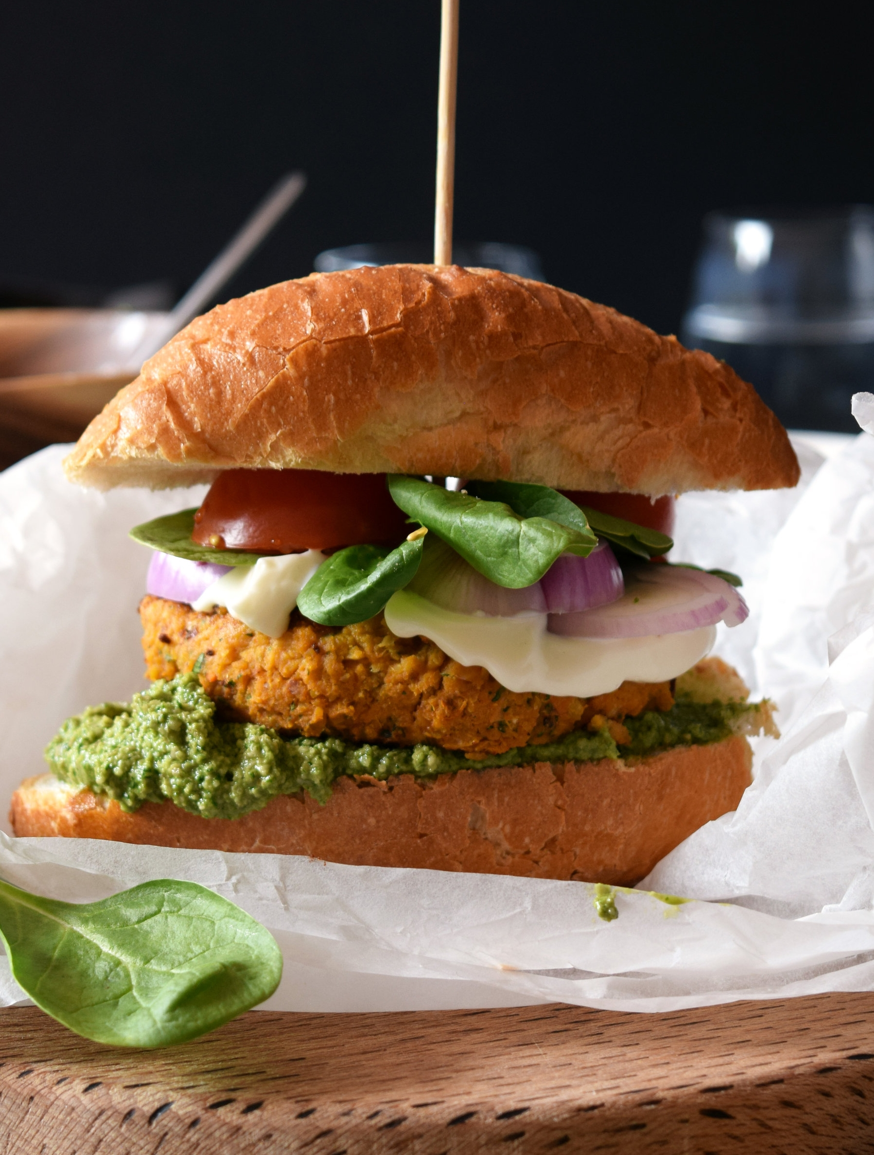Sweet potato and chickpea burger with spinach pesto.