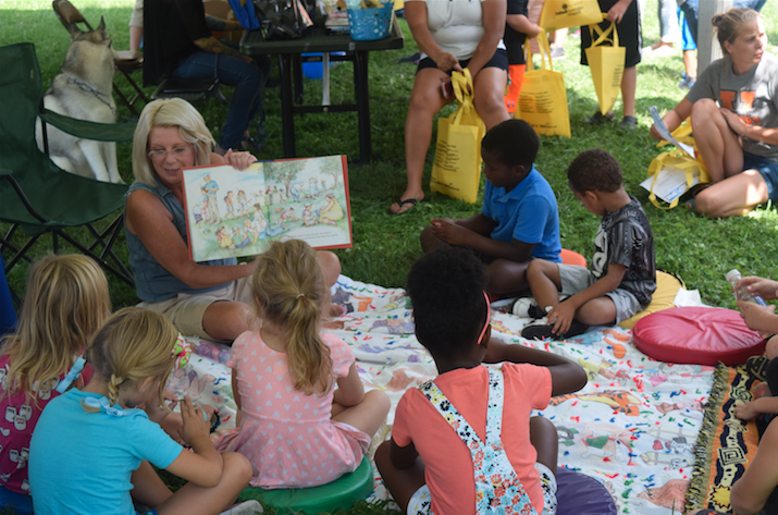 "A Huntington woman reads to a group of children as part of the KidsFest theme ""Healthy Minds, Healthy Bodies, and Healthy Futures."""