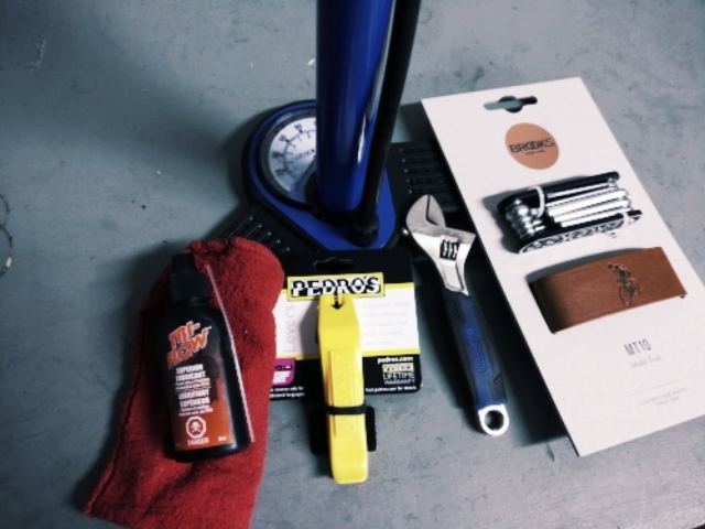 The basic tools of bike repair. Lubricant, tire levers, a floor pump with pressure gauge, small wrench, and a multi-tool (or set of allen wrenches and a screwdriver). We have tools available for purchase, and they make great stocking-stuffers!