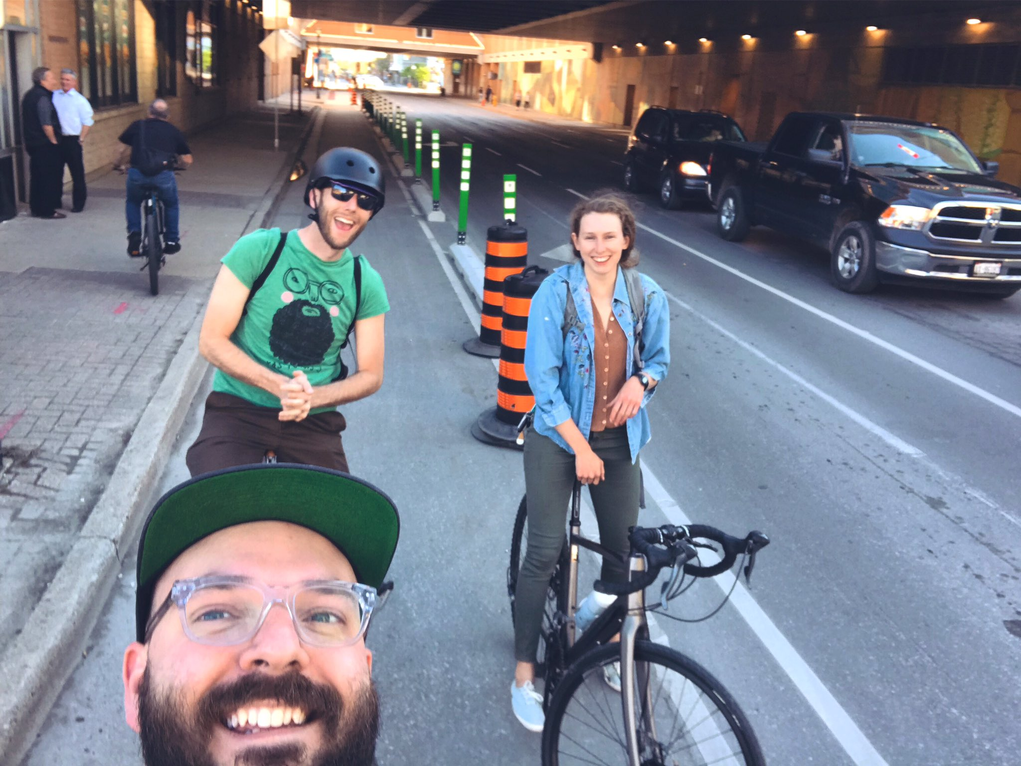 Smiling happy people in the King Street protected bike lane! (Photo:  @stevemacdouell )