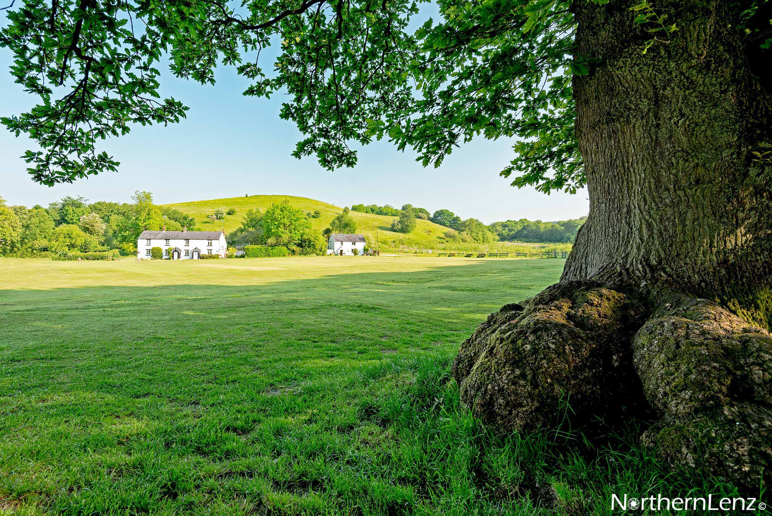 Looking across the cricket pitch at White Coppice, a hamlet in Lancashire  Image Ref: MT12