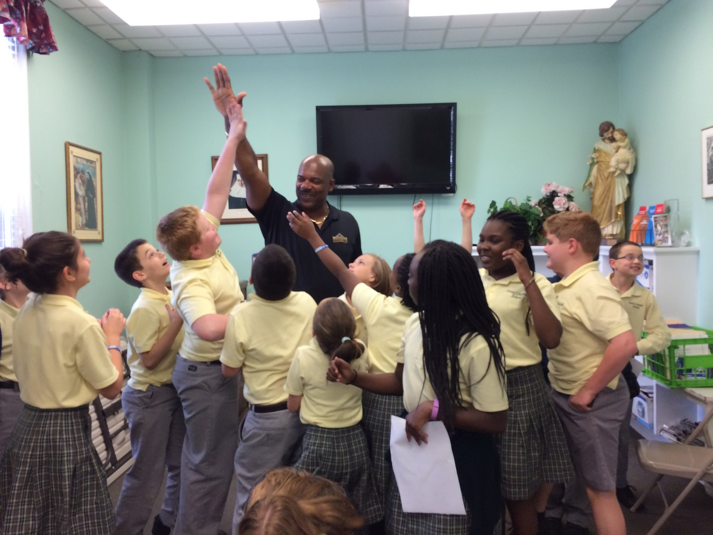 """Mr. Fred Baxter, two -time NFL Superbowl winner, interacts with members of the Mission Club on the topic of """"Making a Difference in the World Through Service."""""""
