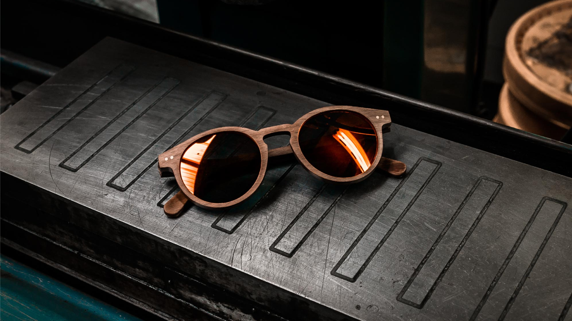 - We create premium sunglasses using premium materials and lenses.Our designs are created here by us in the United Kingdom, our frames are inspired by motorsports and the use of extreme materials.Based on our roots of extreme sports/lifestyle and exploratory nature we want to merge a sense of sophistication, adrenaline fuelled adventure and active life style to inspire our approach to traditional pair of sunglasses.