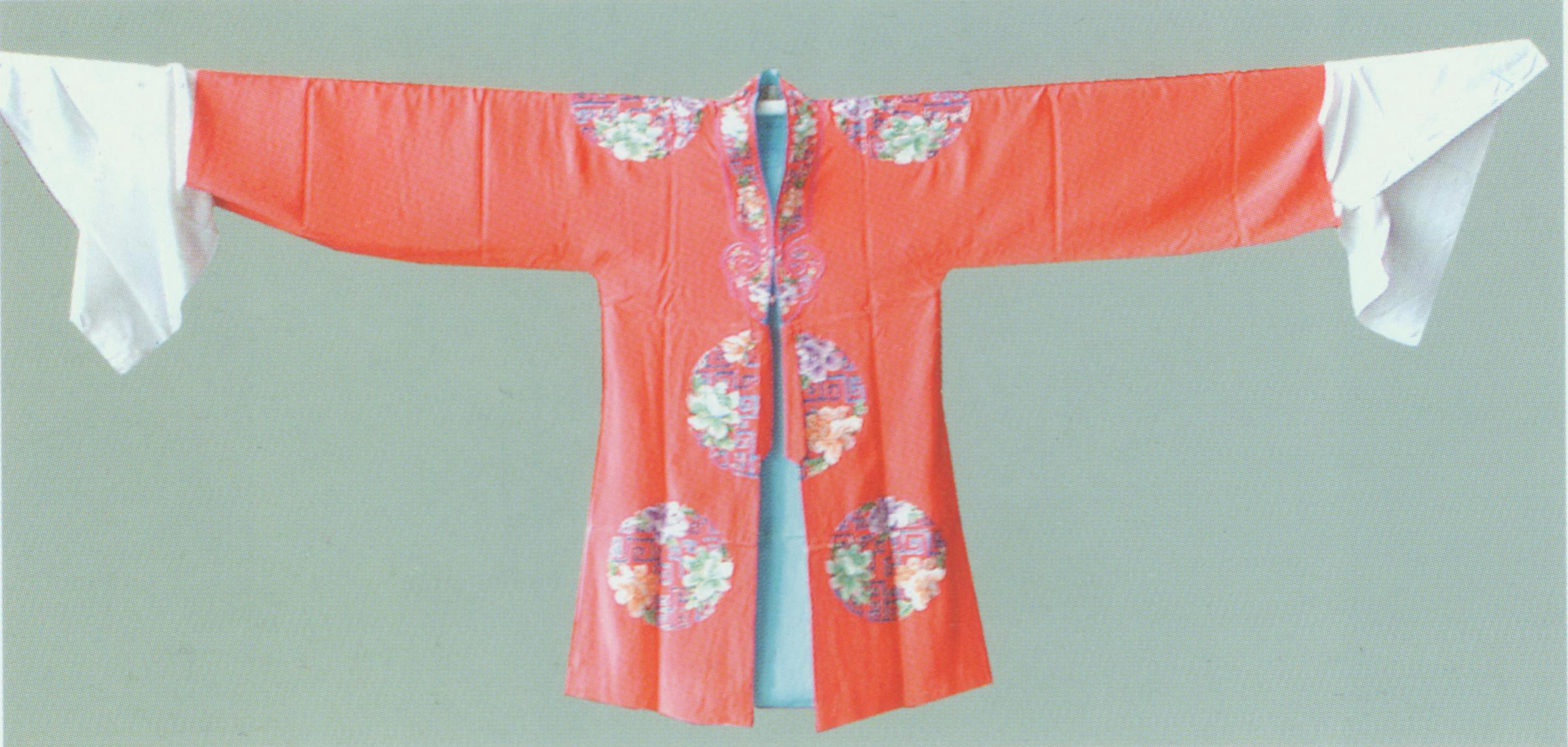 The Pair of Red Robes (Men and Women) Costume .   The pair of is distinguished by its embroidered patterns like flowers in round frame, Chinese frets and rattans. Typically, officials and young ladies will wear red robes when they get married or have reunion. For example, Zhao Chong and Gui Zhi wear a pair of read robe in  The Story of Selling Horses .