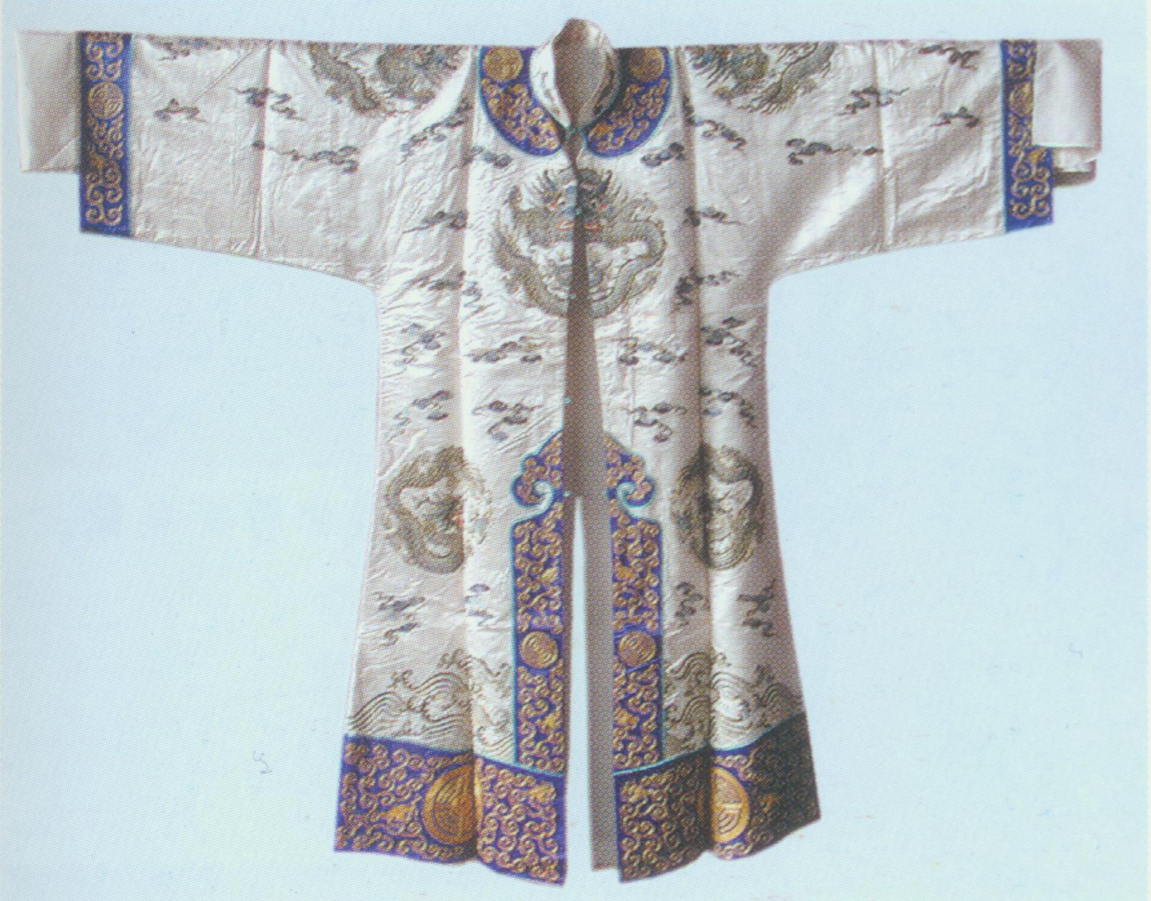 "Longtao yi   Theatrical costume worn by attendants (longtao). It has symmetrical opening with long collar band,top sleeves and water sleeves. And the fungus-shaped arabesque finishes the top of the center back slit, with undulant borders. Besides, the neckline, cuffs, edges of the opening in the front and back slit are all hemmed with colorful bands with motifs of acient coins, flowers, dragons and geometrical patterns. Several dragons are embroidered on the sleeves, front and back piece along with clouds and sea waves. Longtao usually come in groups of four as the guards. They process on stage carrying banners at the battle scene to present a strong army. the color is selected to match or harmonize with the principle roles they serve. The Red robe is called ""hong longtao"", white called ""bai longtao""."