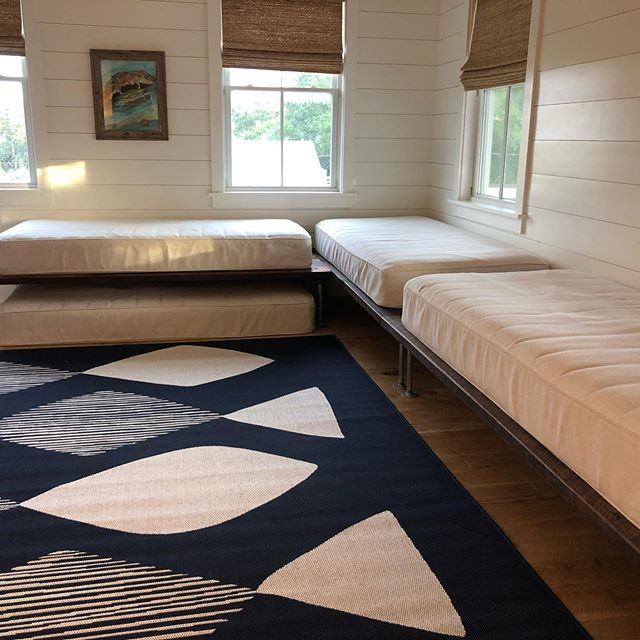 """These gorgeous reclaimed heart pine """"beds"""" finally have their home in a media room on Isle of Palms ♥️. Remove the legs & you have 40x80 tabletops ♥️♥️. EBWoodWorks.com  #reclaimedheartpine #antiqueheartpine #moderndaybunks #heartpinetables"""