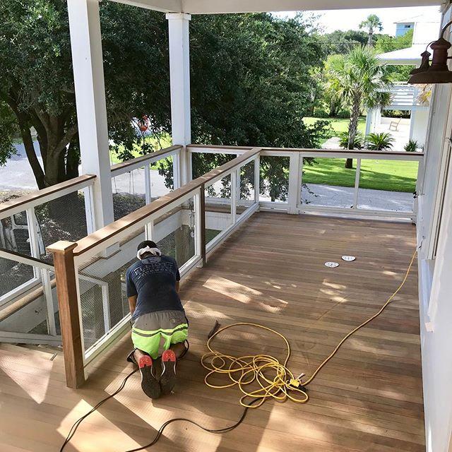Ipe decks getting a little face lift.  #ipedecking #frontporchliving #isleofpalmshomes #sandandfinish  EBWoodWorks.com
