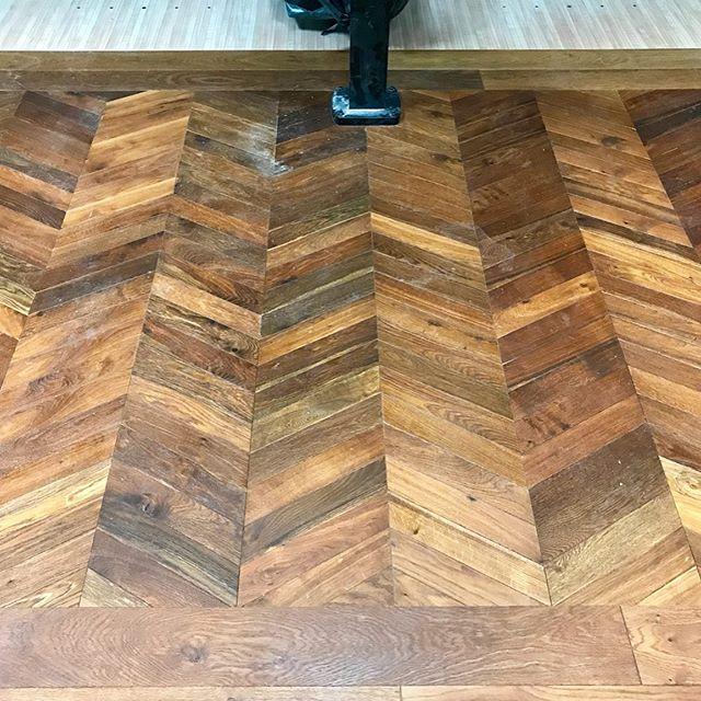 Chevron, borders & planks are bringing this hip bowling alley to life!  #choateconstruction #seaislandgeorgia #chevronfloor #floorborder #commercialconstruction