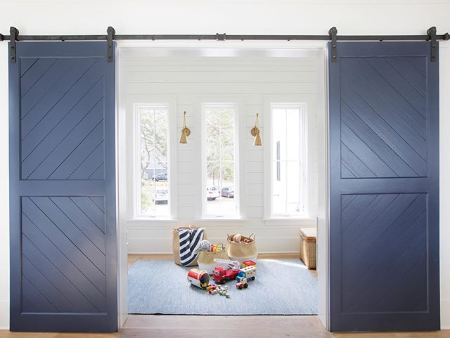Not all barn doors are made from reclaimed barn wood. These are beautifully designed painted pine doors.  www.EBWoodworks.com  #barndoors #slidingdoors #reclaimedbarndoors #painteddoors  Photo Cred   @margaret.wright