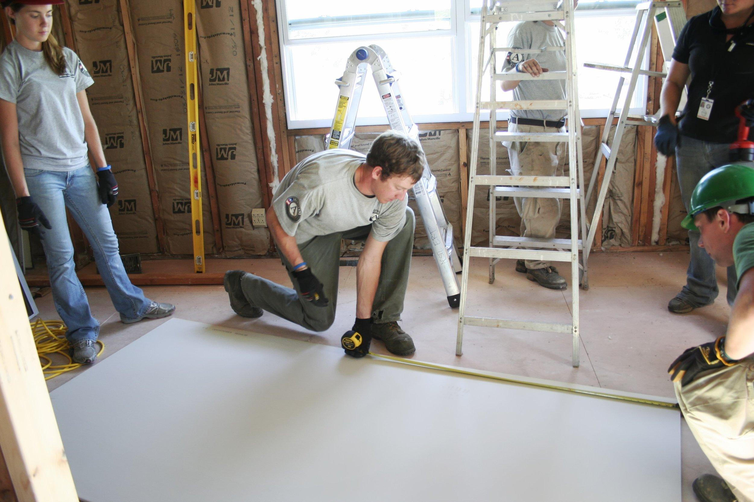 Members help to rebuild a homeowners home in Joplin, MO.