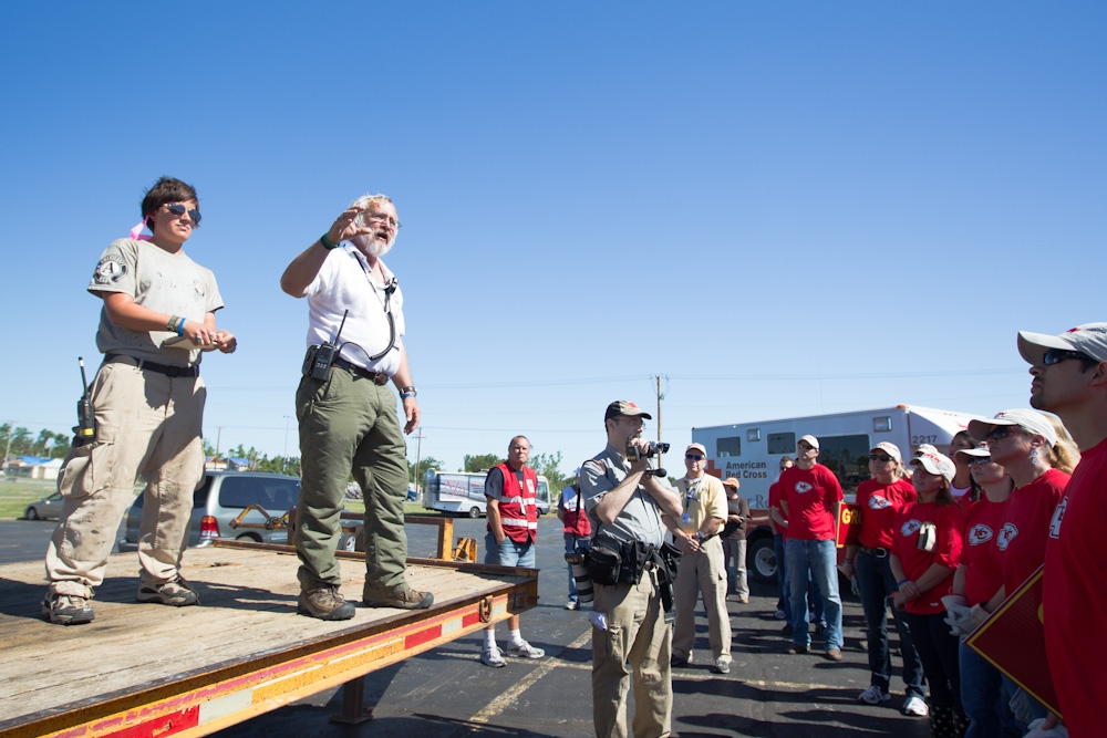 Bruce Bailey, Executive Director of the AmeriCorps St. Louis Emergency Response Team gives direction to the Kansas City Chiefs volunteers before heading out into the field in Joplin. (Photo by Scott Julian, 2011)