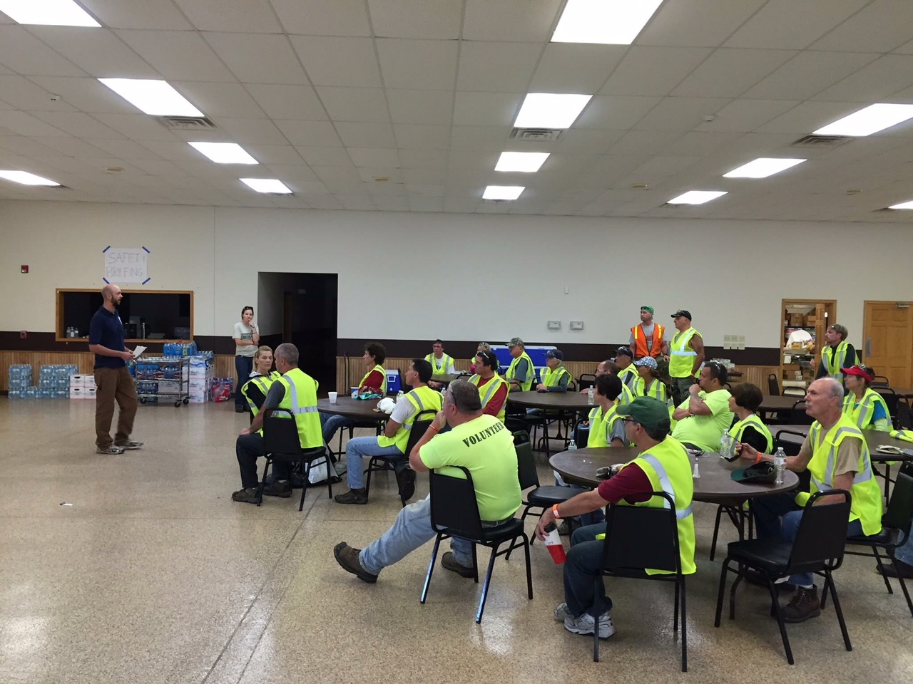 Year 21 member, Mike Rood, provides a safety briefing for volunteers during the Coal City, Illinois, 2015 tornado response (Photo by Kelley Hower, Year 21)